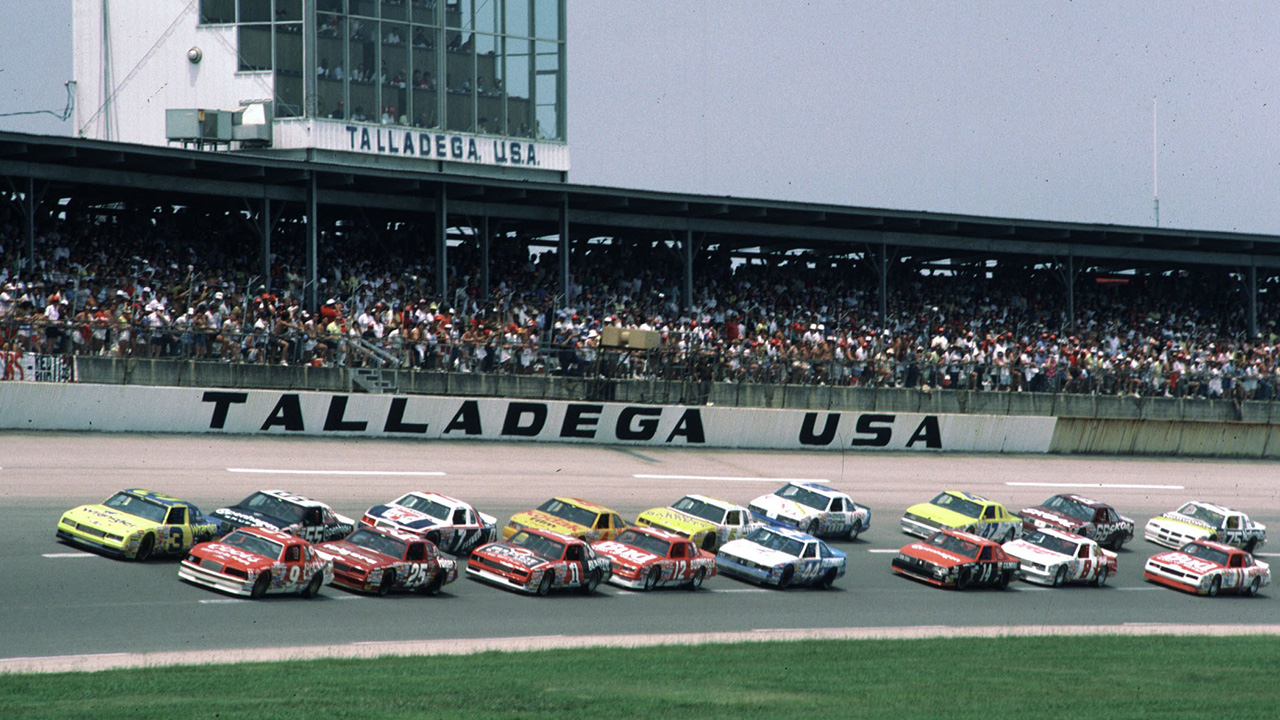 TALLADEGA, AL - JULY 27, 1986:  Bill Elliott (No. 9) and Dale Earnhardt (No. 3) make up the front row for the '86 Talladega 500. Shown back in the pack, Bobby Hillin (No. 8) won the race.  (Photo by ISC Archives via Getty Images)