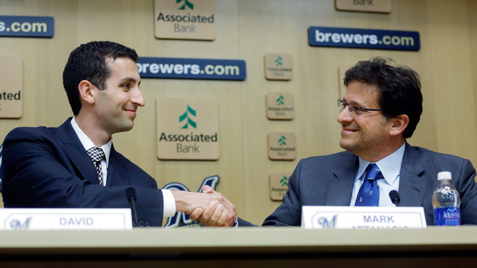 David Stearns shakes hands with Milwaukee Brewers owner Mark Attanasio during a news conference Monday, Sept. 21, 2015, in Milwaukee. Stearns was introduced as the Brewers' new general manager. (AP Photo/Morry Gash)