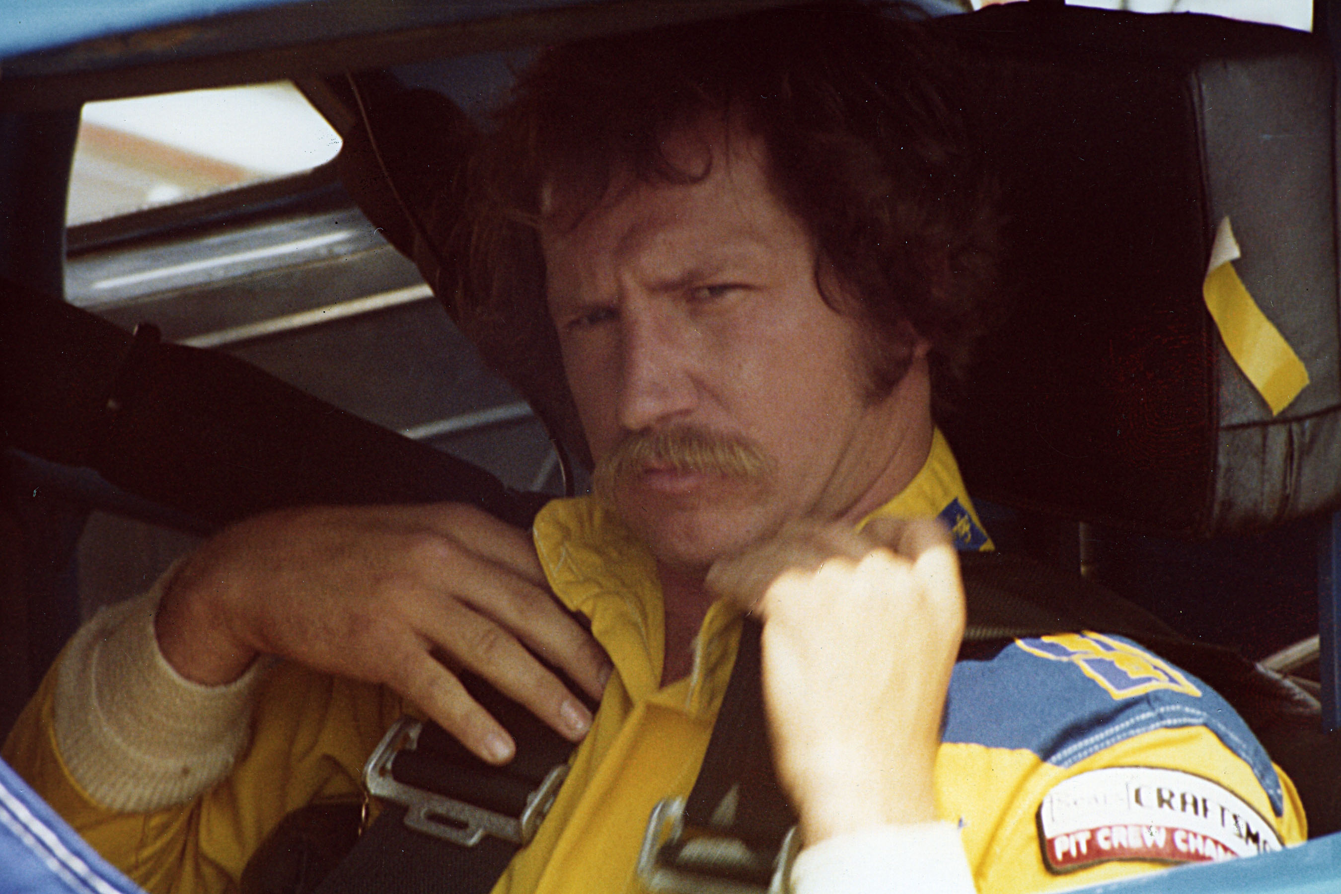 UNKNOWN – 1981: After winning the 1980 NASCAR Cup title in just his second full season on the circuit, the following season would be one of turmoil for Dale Earnhardt.  He and his sponsor, Wrangler, would see the Pontiacs Earnhardt drove have three different owners during the year.  After racing for Rod Osterlund in the first 16 events, the team was sold to Jim Stacy.  After just four races with Stacy, Earnhardt and his sponsor moved to the Richard Childress operation for the rest of the year.  The ride-hopping took its toll, as Earnhardt was shut out of victory lane, but still managed to finish seventh in Cup points.  (Photo by ISC Images & Archives via Getty Images)