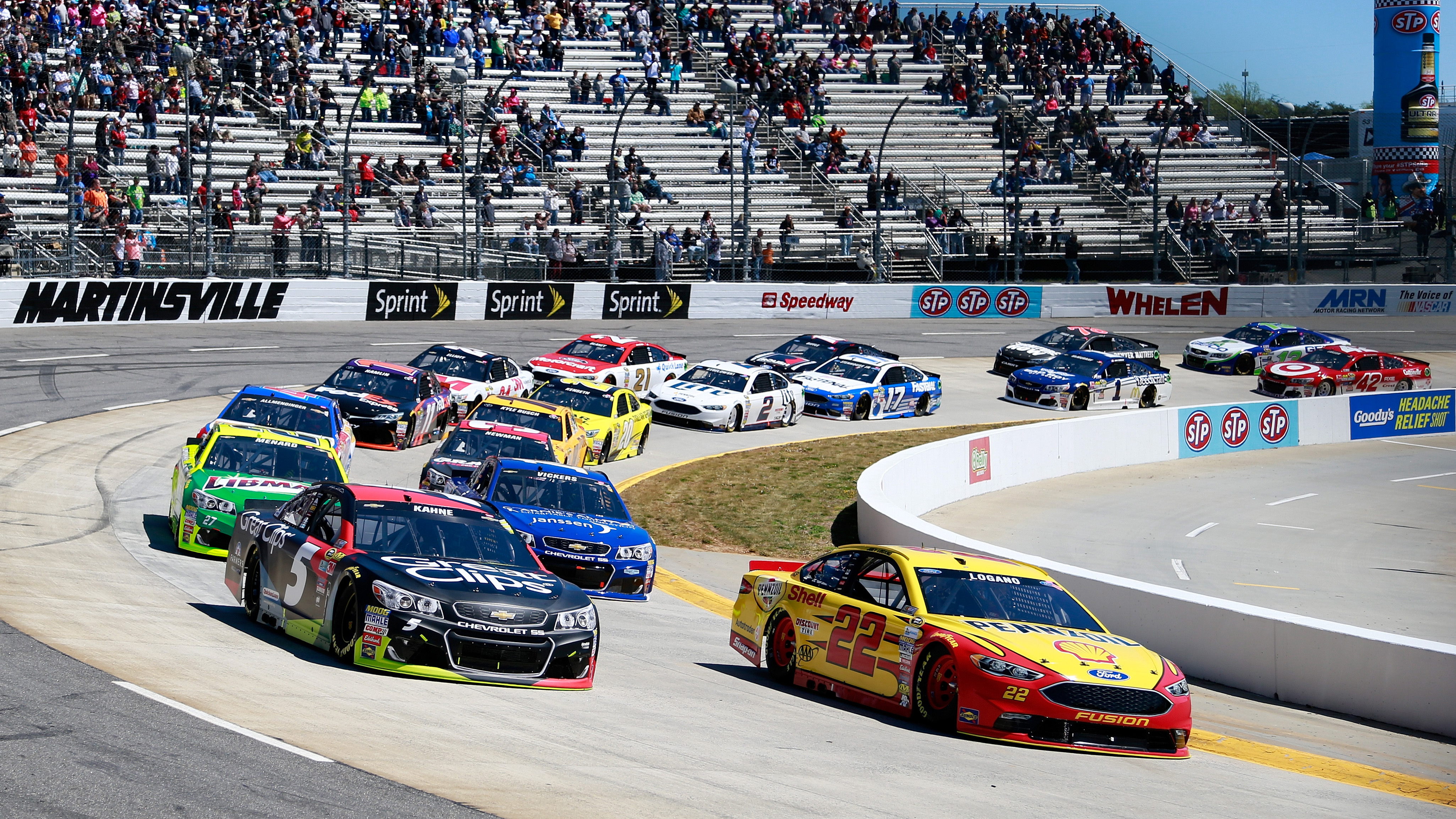 MARTINSVILLE, VA - APRIL 03:  Kasey Kahne, driver of the #5 Great Clips Chevrolet, and Joey Logano, driver of the #22 Shell Pennzoil Ford, lead the field to start the NASCAR Sprint Cup Series STP 500 at Martinsville Speedway on April 3, 2016 in Martinsville, Virginia.  (Photo by Matt Sullivan/NASCAR via Getty Images)