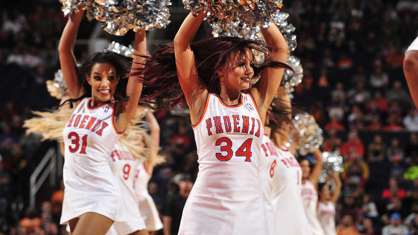 PHOENIX, AZ - NOVEMBER 27: The Phoenix Suns dance team performs during the game against the Denver Nuggets on November 27, 2016 at Talking Stick Resort Arena in Phoenix, Arizona. NOTE TO USER: User expressly acknowledges and agrees that, by downloading and or using this photograph, user is consenting to the terms and conditions of the Getty Images License Agreement. Mandatory Copyright Notice: Copyright 2016 NBAE (Photo by Barry Gossage/NBAE via Getty Images)