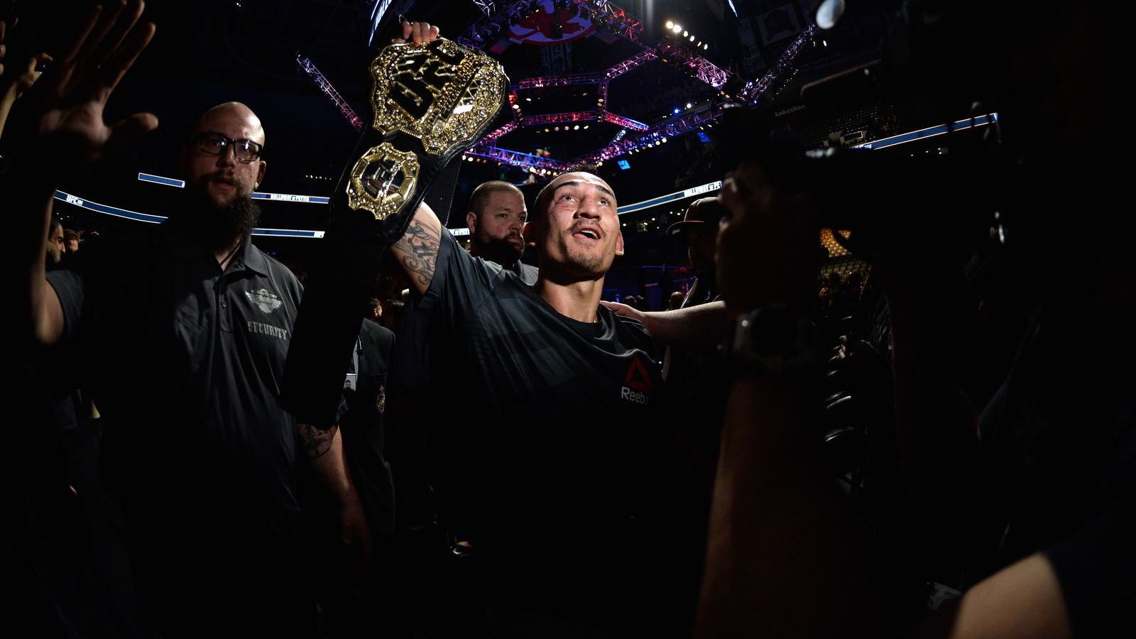 TORONTO, CANADA - DECEMBER 10:  Max Holloway celebrates his victory over Anthony Pettis in their interim UFC featherweight championship bout during the UFC 206 event inside the Air Canada Centre on December 10, 2016 in Toronto, Ontario, Canada. (Photo by Brandon Magnus/Zuffa LLC/Zuffa LLC via Getty Images)