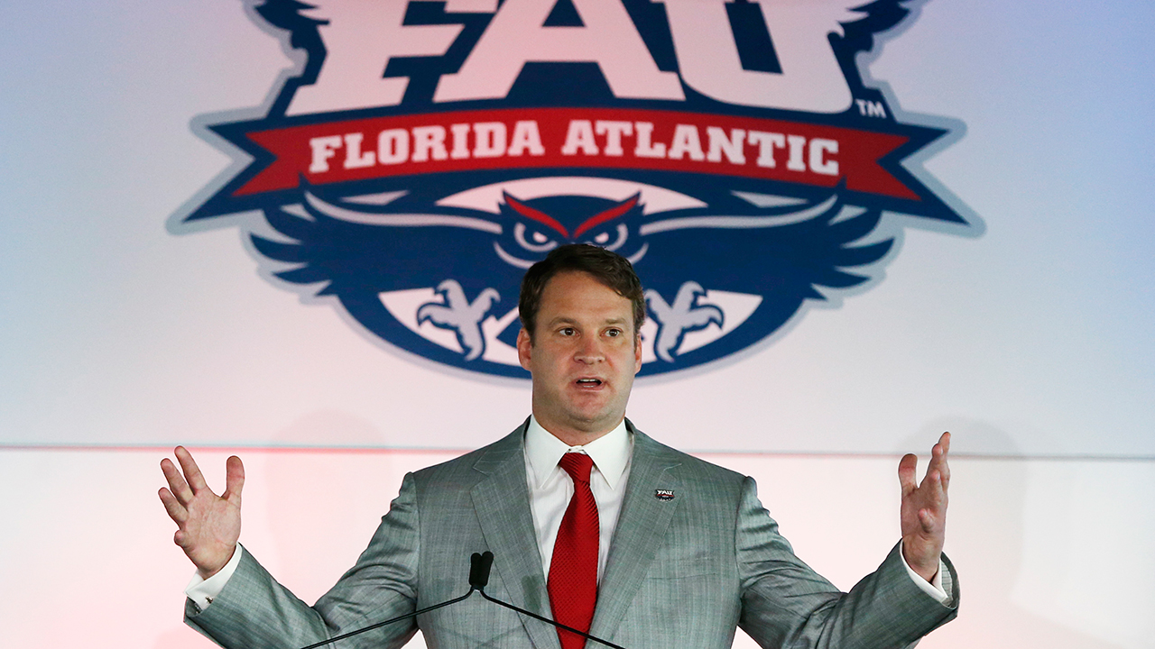 Lane Kiffin gestures as he speaks after being introduced as the new Florida Atlantic NCAA college head football coach, Tuesday, Dec. 13, 2016, in Boca Raton, Fla. Kiffin will return to Alabama to continue running the No. 1-ranked Crimson Tide's offense in the College Football Playoff, which starts Dec. 31 with a semifinal game against No. 4 Washington. (AP Photo/Wilfredo Lee)