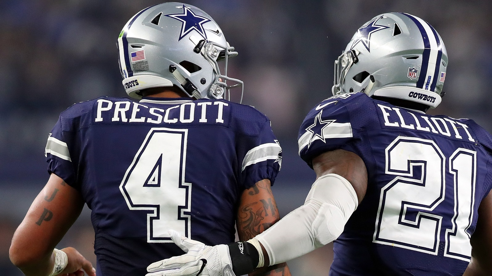 ARLINGTON, TX - NOVEMBER 24:   Dak Prescott #4 of the Dallas Cowboys celebrates with Ezekiel Elliott #21 after scoring a touchdown during the fourth quarter against the Washington Redskins at AT&T Stadium on November 24, 2016 in Arlington, Texas.  (Photo by Tom Pennington/Getty Images)