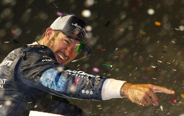 DARLINGTON, SC - SEPTEMBER 04: Martin Truex, Jr., driver of the #78 Auto-Owners Insurance Toyota, celebrates in Victory Lane after winning the NASCAR Sprint Cup Series Bojangles' Southern 500 at Darlington Raceway on September 4, 2016 in Darlington, South Carolina.  (Photo by Brian Lawdermilk/Getty Images)