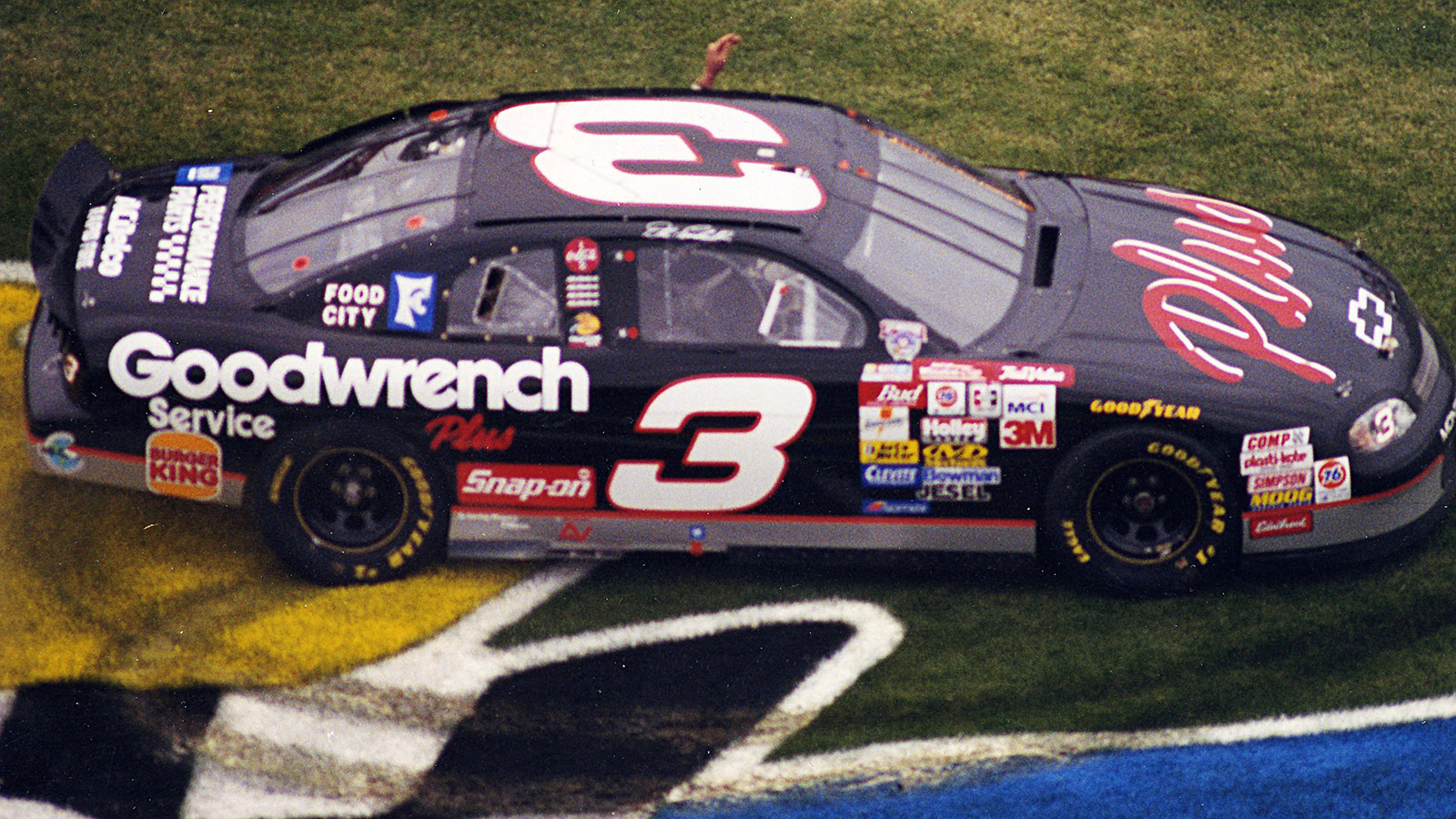 DAYTONA BEACH, FL - FEBRUARY 15, 1998:  Dale Earnhardt celebrates after winning the Daytona 500.  (Photo by ISC Archives via Getty Images)