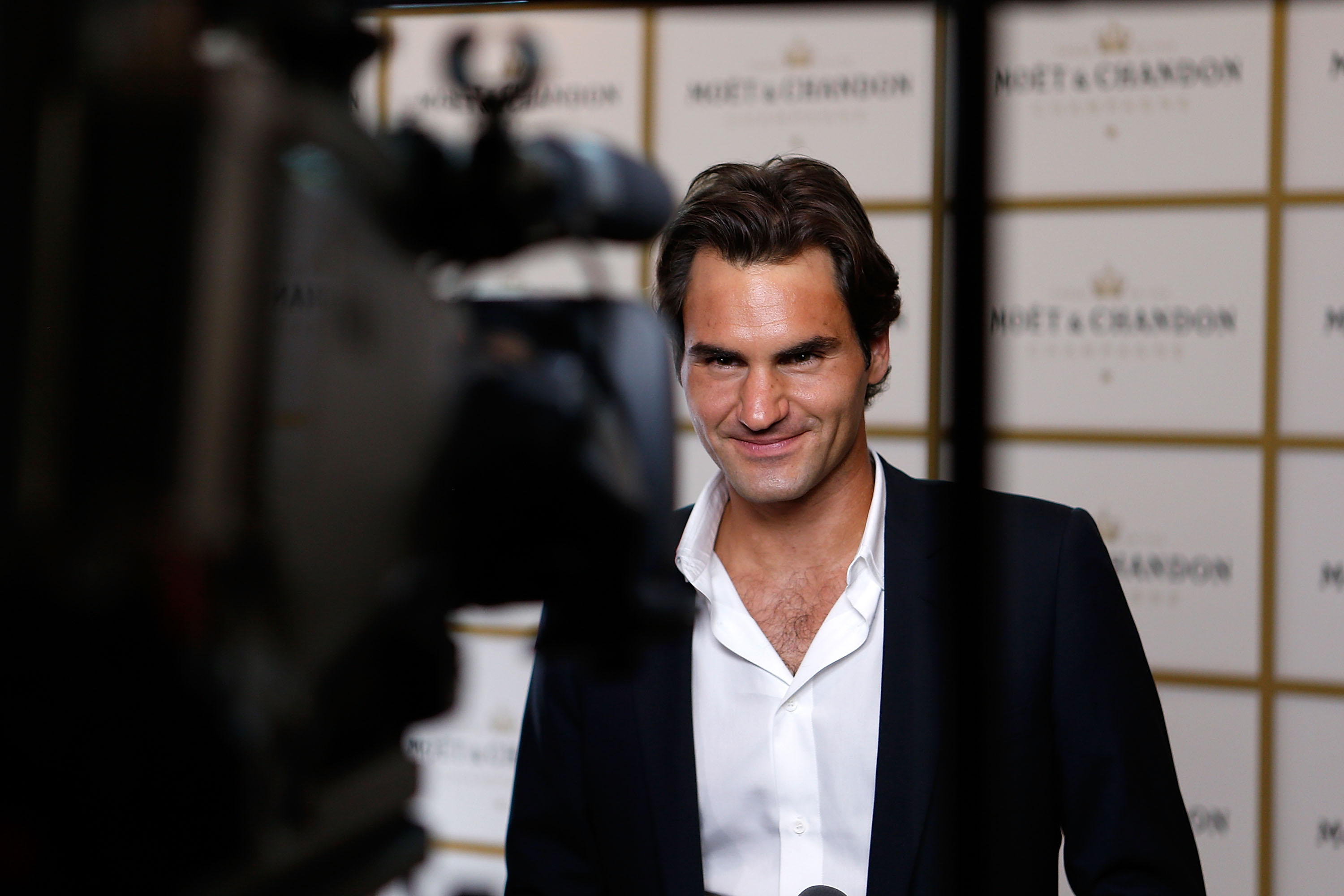 MELBOURNE, AUSTRALIA - JANUARY 09:  Roger Federer arrives at the Moet & Chandon Party at Melbourne's Crown Casiono on January 9, 2014 in Melbourne, Australia.  (Photo by Darrian Traynor/Getty Images)