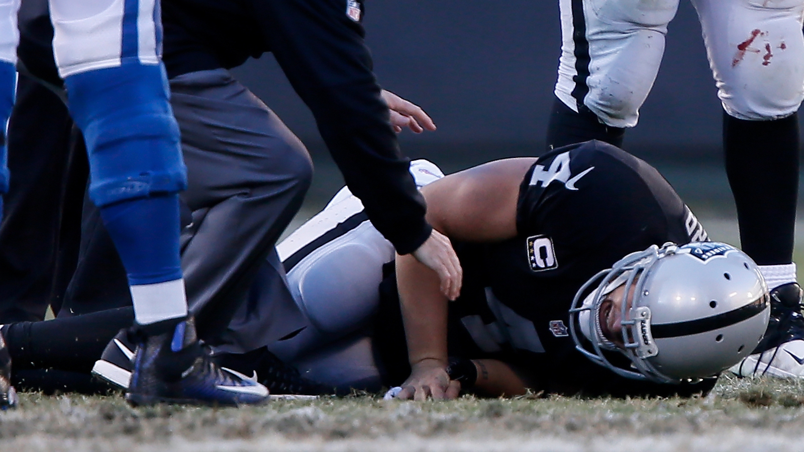 OAKLAND, CA - DECEMBER 24:  Derek Carr #4 of the Oakland Raiders lays on the field after injuring his right leg during their NFL game against the Indianapolis Colts at Oakland Alameda Coliseum on December 24, 2016 in Oakland, California.  (Photo by Brian Bahr/Getty Images)