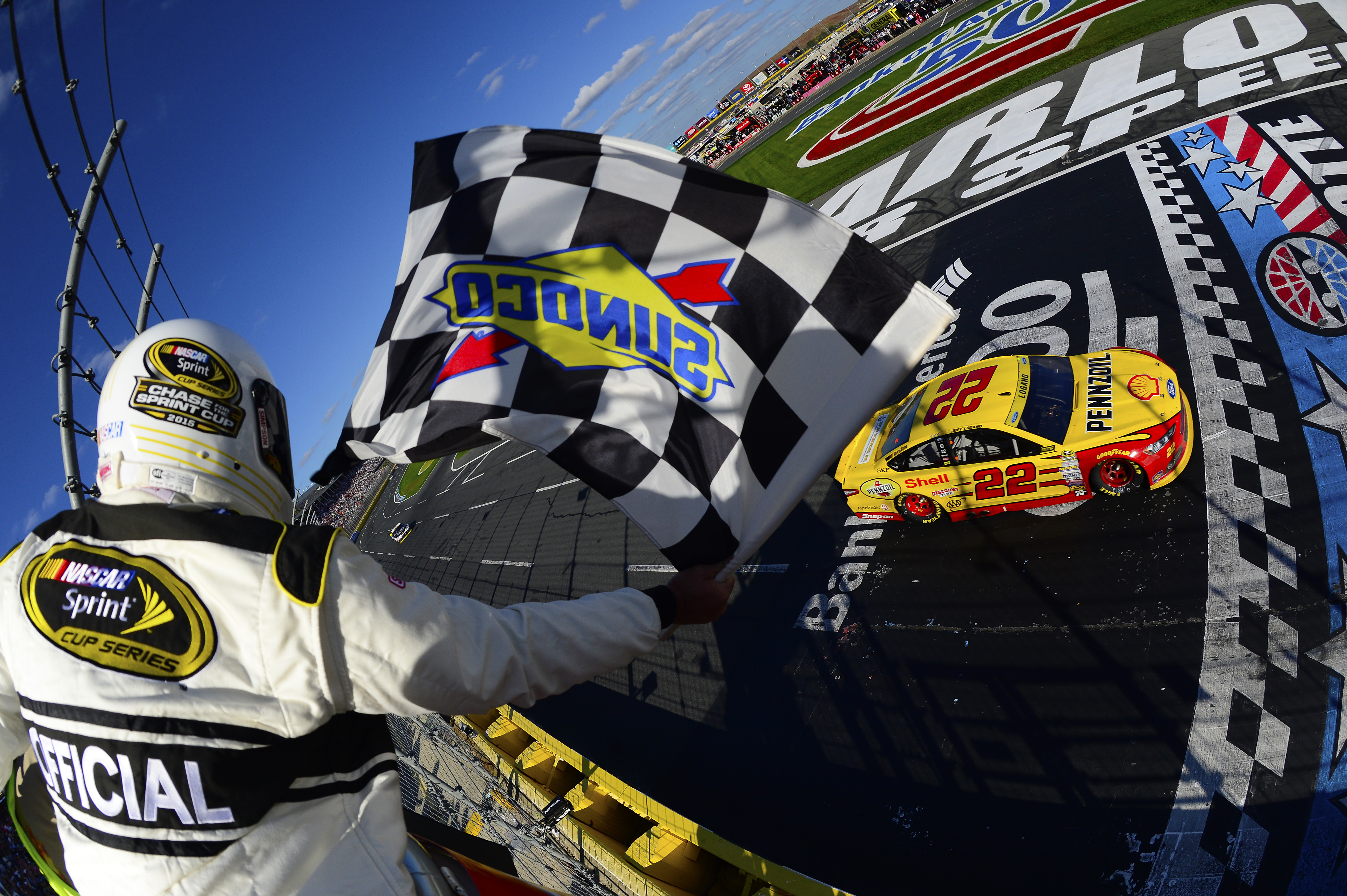 CHARLOTTE, NC - OCTOBER 11:  Joey Logano, driver of the #22 Shell Pennzoil Ford, races to the checkered flag to win the NASCAR Sprint Cup Series Bank of America 500 at Charlotte Motor Speedway on October 11, 2015 in Charlotte, North Carolina.  (Photo by Robert Laberge/NASCAR via Getty Images)