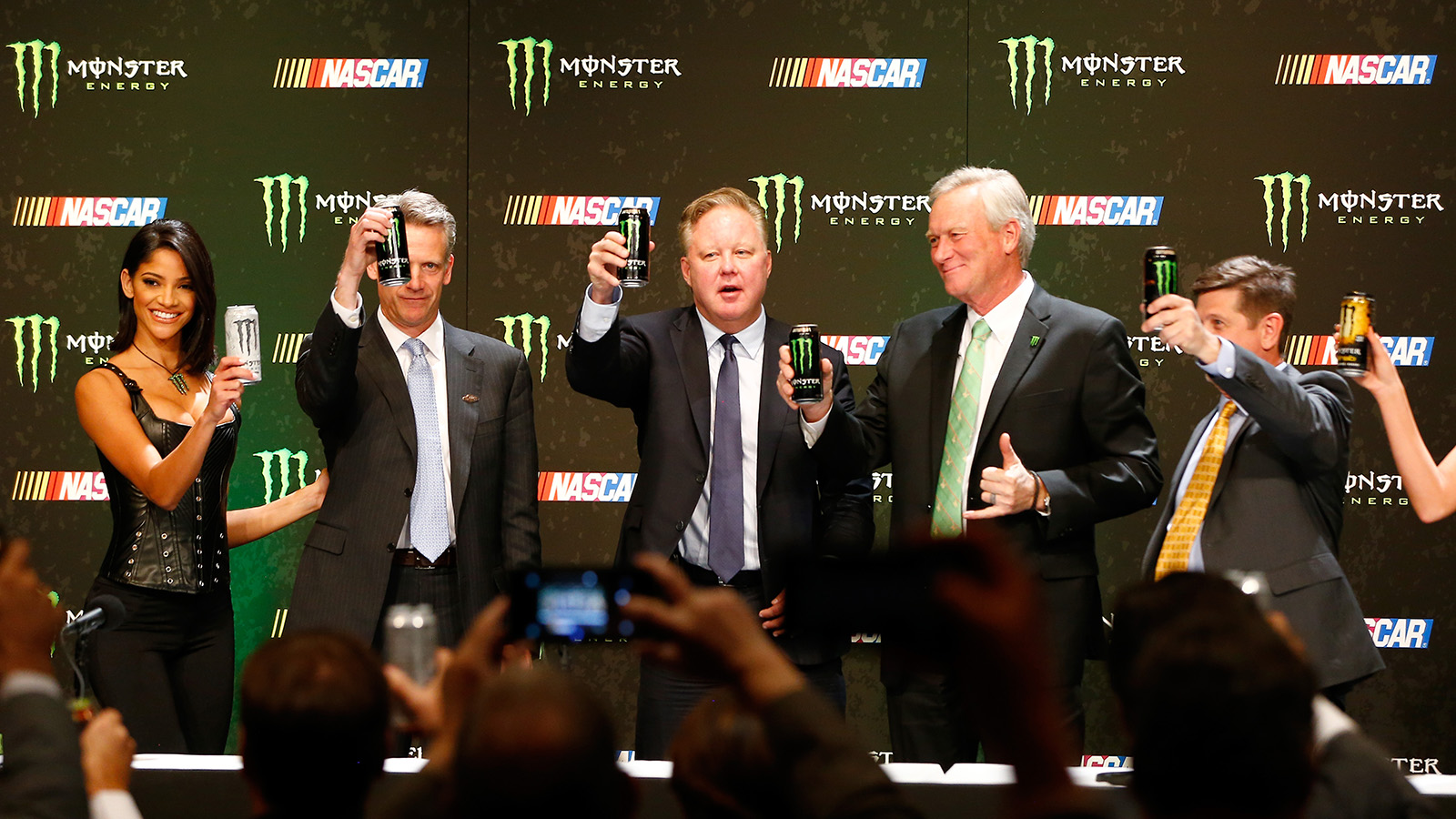 LAS VEGAS, NV - DECEMBER 01:  Steve Phelps, Brian France, Mark Hall and Mitch Covington toast during a press conference as NASCAR and Monster Energy announce premier series entitlement partnership at Wynn Las Vegas on December 1, 2016 in Las Vegas, Nevada. Monster Energy, which will begin its tenure as naming rights partner on Jan. 1, 2017, will become only the third company to serve as the entitlement sponsor in NASCAR premier series history, following RJ Reynolds and Sprint/Nextel.  (Photo by Jonathan Ferrey/Getty Images)