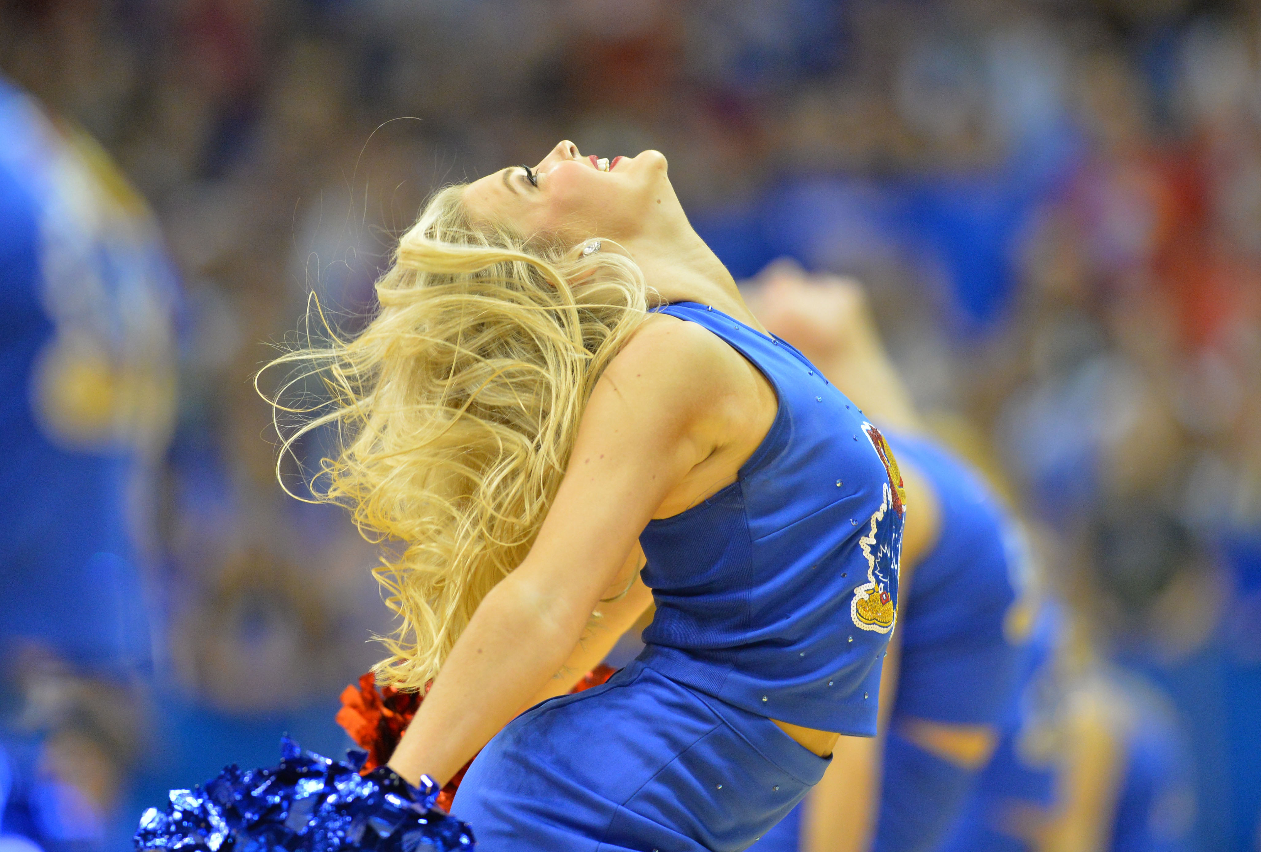 Nov 18, 2016; Lawrence, KS, USA; Kansas Jayhawks cheerleaders entertain fans during the second half against the Siena Saints at Allen Fieldhouse. Kansas won 86-65. Mandatory Credit: Denny Medley-USA TODAY Sports