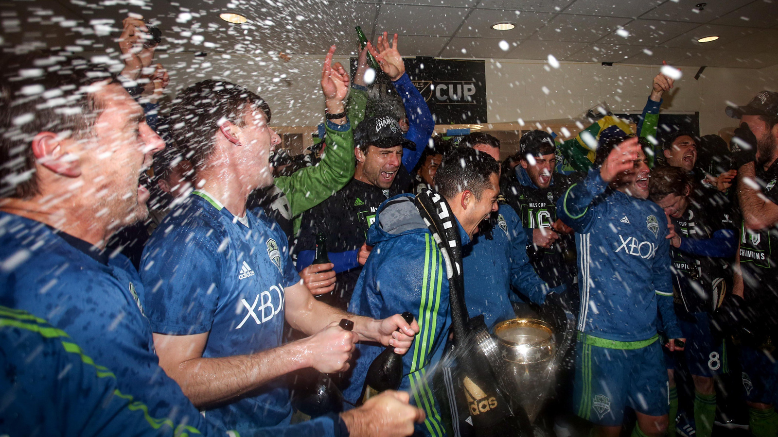 Dec 10, 2016; Toronto, Canada; Seattle Sounders celebrate their win over Toronto FC with champagne in the 2016 MLS Cup at BMO Field. Mandatory Credit: Geoff Burke-USA TODAY Sports