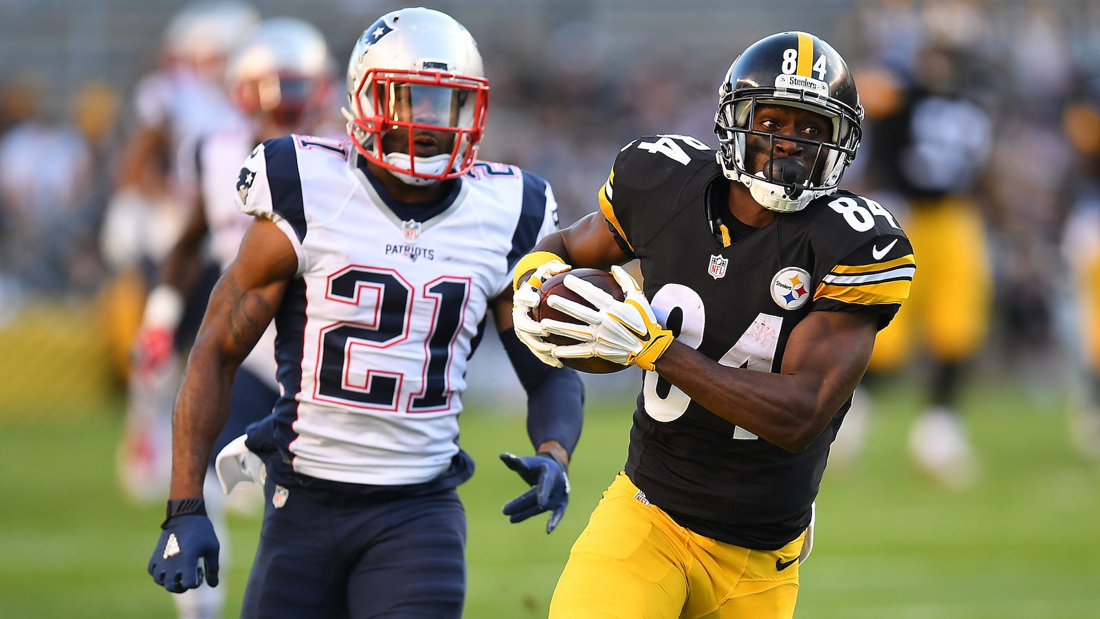 PITTSBURGH, PA - OCTOBER 23:  Antonio Brown #84 of the Pittsburgh Steelers is pursued by Malcolm Butler #21 of the New England Patriots after making a catch in the first half during the game at Heinz Field on October 23, 2016 in Pittsburgh, Pennsylvania. (Photo by Joe Sargent/Getty Images)