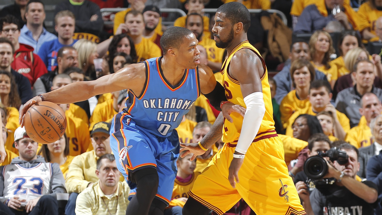 CLEVELAND, OH - JANUARY 25: Russell Westbrook #0 of the Oklahoma City Thunder handles the ball against Kyrie Irving #2 of the Cleveland Cavaliers on January 25, 2015 at Quicken Loans Arena in Cleveland, Ohio. NOTE TO USER: User expressly acknowledges and agrees that, by downloading and or using this Photograph, user is consenting to the terms and condition of the Getty Images License Agreement. (Photo by Rocky Widner/Getty Images)