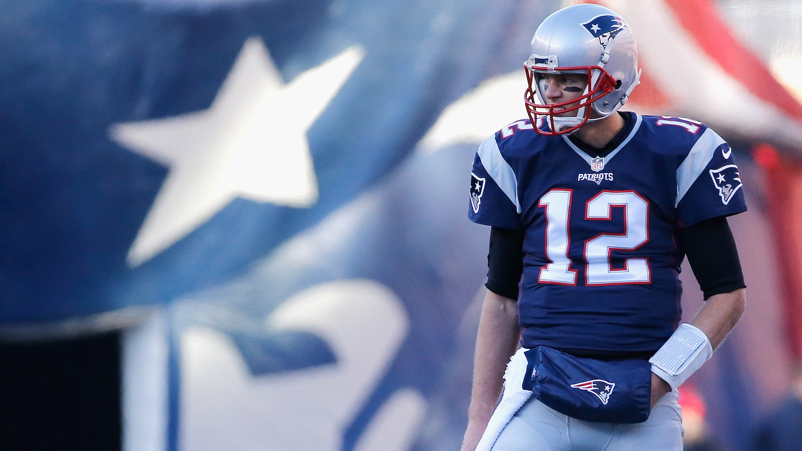 FOXBORO, MA - DECEMBER 04:  Tom Brady #12 of the New England Patriots looks on during the first half against the Los Angeles Rams at Gillette Stadium on December 4, 2016 in Foxboro, Massachusetts.  (Photo by Jim Rogash/Getty Images)