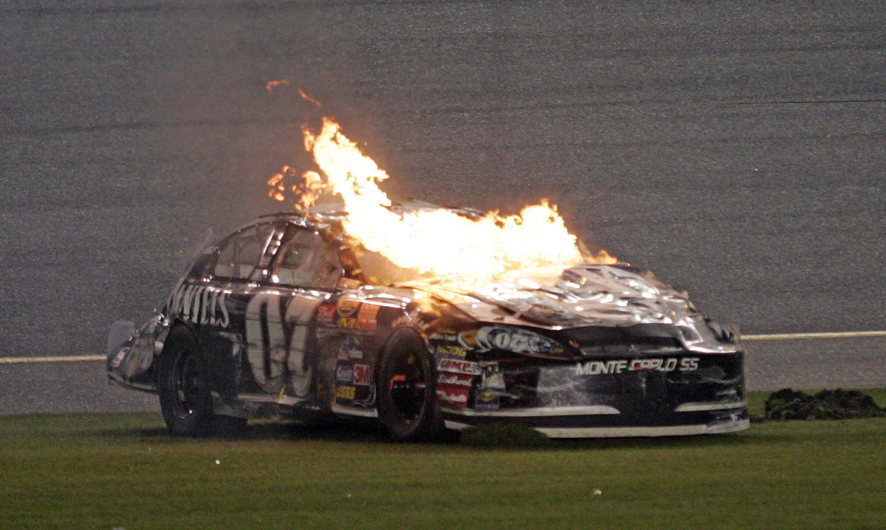 Clint Bowyer's car burnsafter a last lap crash in the NASCAR Nextel Cup Daytona 500 at Daytona International Speedway in Daytona Beach, Florida, Sunday, February 18, 2007. (Photo by Gregg Ellman/Fort Worth Star-Telegram/MCT via Getty Images)