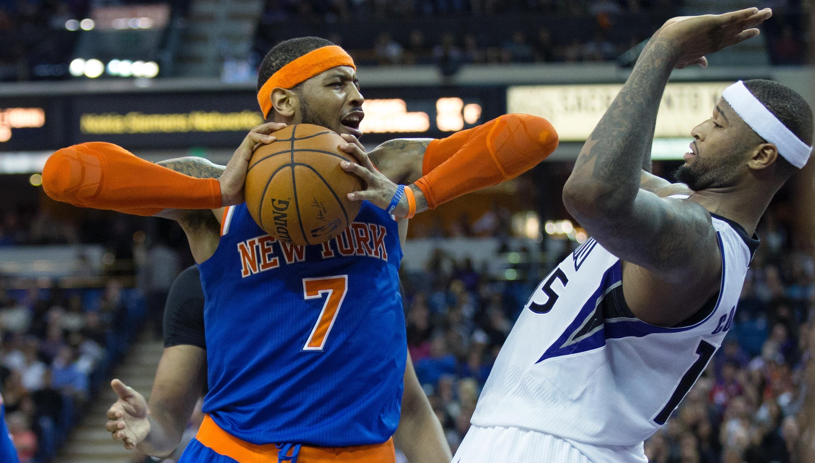 Mar 26, 2014; Sacramento, CA, USA; New York Knicks forward Carmelo Anthony (7) controls the ball against Sacramento Kings center DeMarcus Cousins (15) during the fourth quarter at Sleep Train Arena. The New York Knicks defeated the Sacramento Kings 107-99. Mandatory Credit: Kelley L Cox-USA TODAY Sports