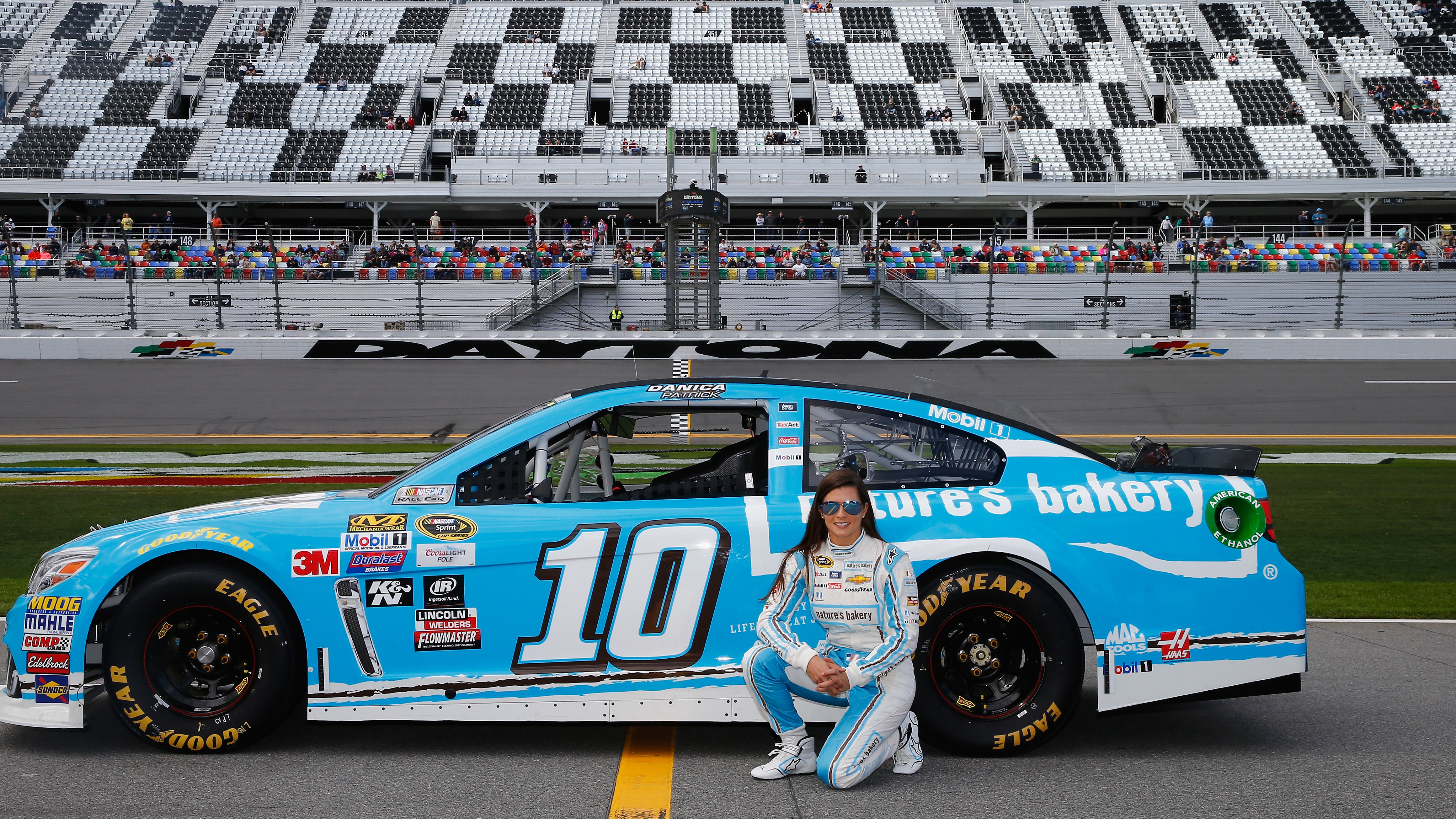13-21 February, 2016, Daytona Beach, Florida USA   Danica Patrick, driver of the #10 Nature's Bakery Chevrolet, poses with her car after qualifying for the NASCAR Sprint Cup Series Daytona 500 at Daytona International Speedway on February 14, 2016 in Daytona Beach, Florida.   LAT Photo USA via NASCAR via Getty Images