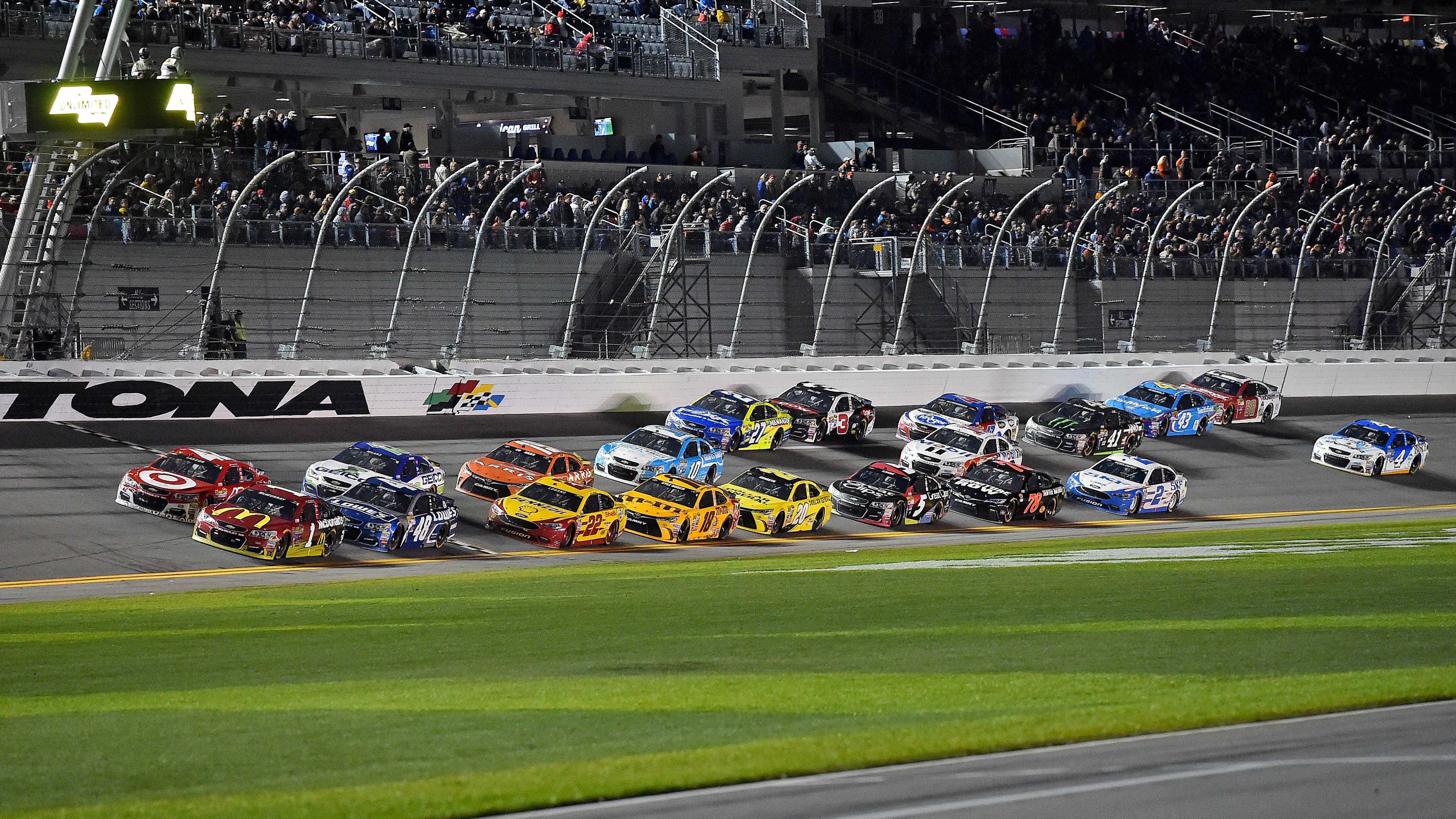 Feb 13, 2016; Daytona Beach, FL, USA; NASCAR Sprint Cup Series driver Jamie Mcmurray (1) and NASCAR Sprint Cup Series driver Kyle Larson (42) lead a pack of cars during The Sprint Unlimited at Daytona International Speedway. Mandatory Credit: Jasen Vinlove-USA TODAY Sports