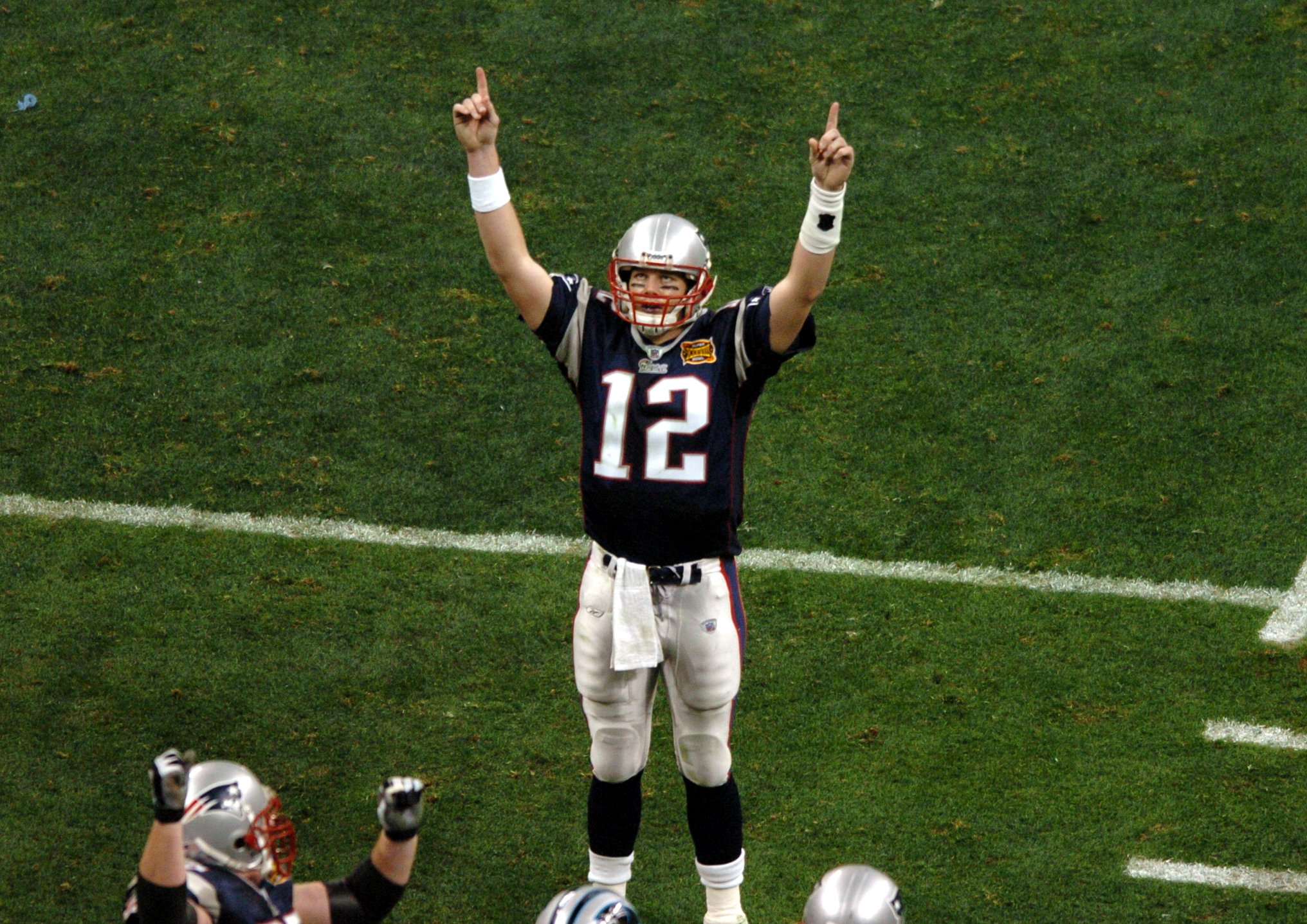 HOUSTON, TX - FEBRUARY 1: New England Patriots quarterback Tom Brady celebrates after touchdown pass to Deion Branch during Super Bowl XXXVIII against the Carolina Panthers. (Photo by Matthew J. Lee/The Boston Globe via Getty Images)