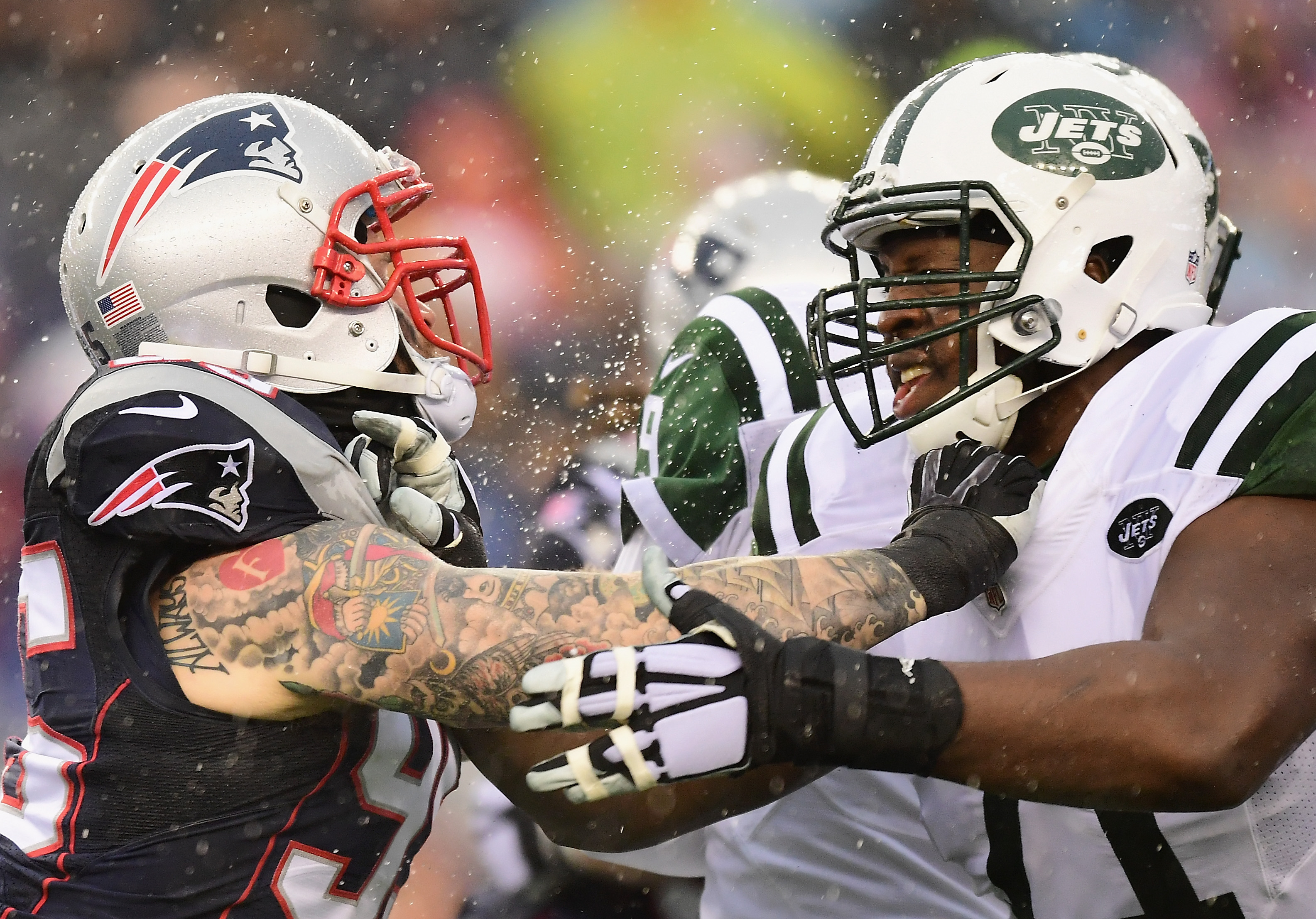 FOXBORO, MA - DECEMBER 24: Chris Long #95 of the New England Patriots blocks Ben Ijalana #71 of the New York Jets during the first quarter of a game at Gillette Stadium on December 24, 2016 in Foxboro, Massachusetts.  (Photo by Billie Weiss/Getty Images)