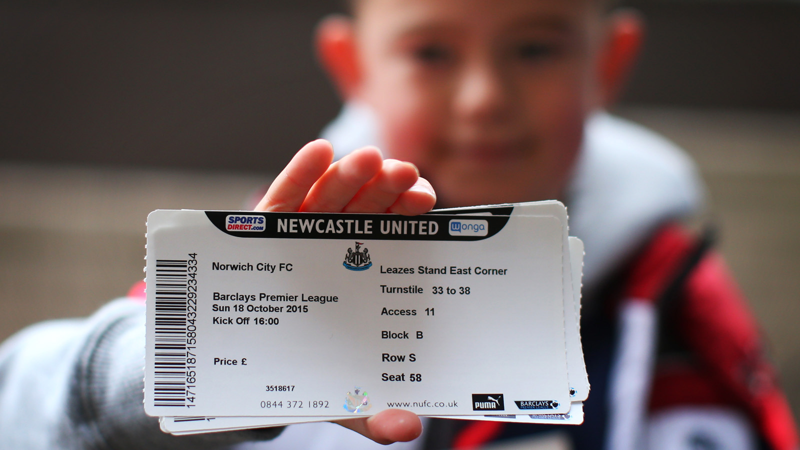 NEWCASTLE, ENGLAND - OCTOBER 18:  A young Newcastle fan shows off  his match ticket during the Barclays Premier League match between Newcastle United and Norwich City at St James Park on October 18, 2015 in Newcastle, England. (Photo by Ian MacNicol/Getty images)