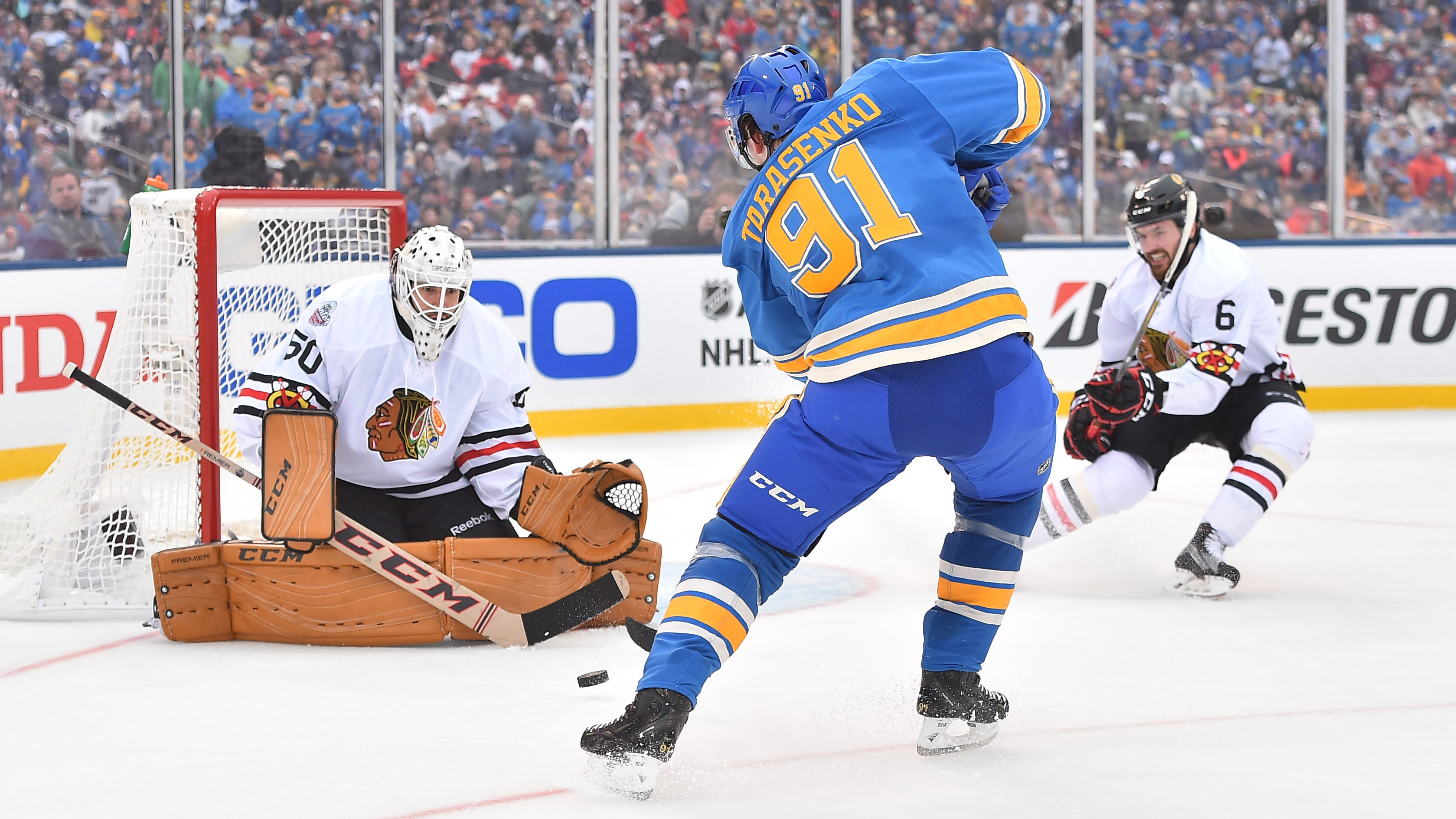 Jan 2, 2017; St. Louis, MO, USA; Chicago Blackhawks goalie Corey Crawford (50) makes a save on a shot by St. Louis Blues right wing Vladimir Tarasenko (91) during the second period in the 2016 Winter Classic ice hockey game at Busch Stadium. Mandatory Credit: Jasen Vinlove-USA TODAY Sports