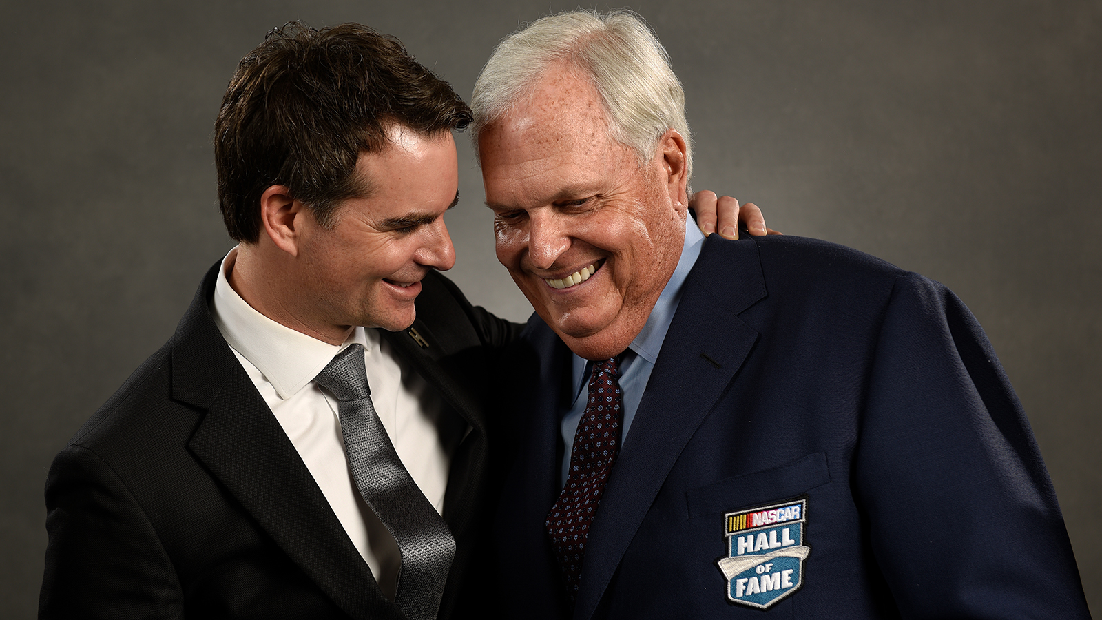 CHARLOTTE, NC - JANUARY 20:  NASCAR Hall of Fame inductee Rick Hendrick(right) and former NASCAR driver Jeff Gordon share a moment prior to the NASCAR Hall of Fame Class of 2017 Induction Ceremony at NASCAR Hall of Fame on January 20, 2017 in Charlotte, North Carolina.  (Photo by Jared C. Tilton/Getty Images)