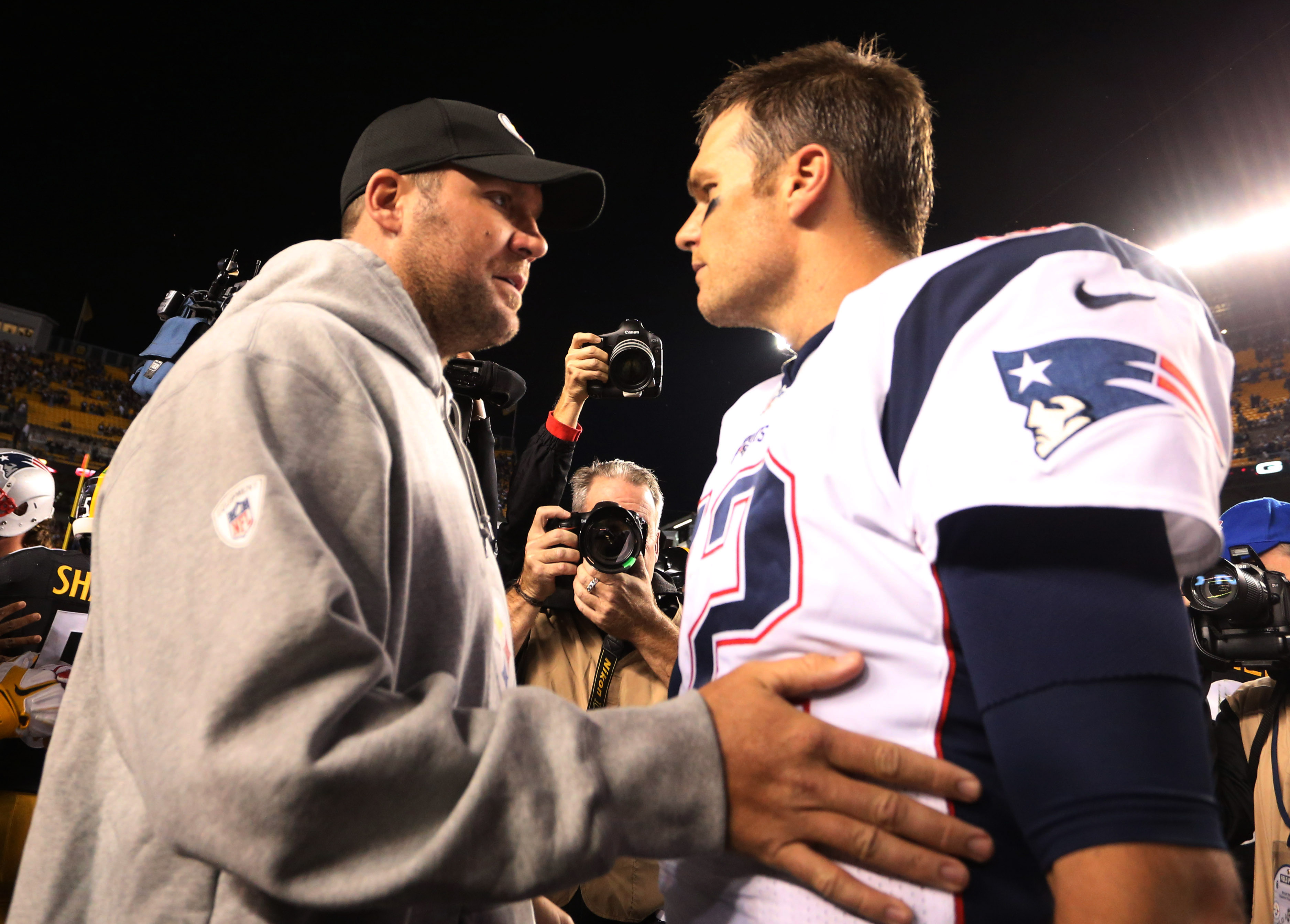 Oct 23, 2016; Pittsburgh, PA, USA;  Pittsburgh Steelers quarterback Ben Roethlisberger (7) and New England Patriots quarterback Tom Brady (12) talk after their game at Heinz Field. New England won 27-16. Mandatory Credit: Charles LeClaire-USA TODAY Sports