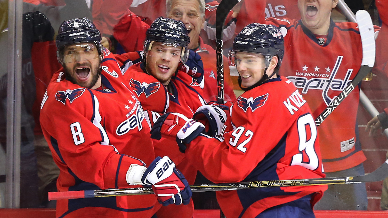 Nov 23, 2016; Washington, DC, USA; Washington Capitals left wing Alex Ovechkin (8) celebrates with Capitals center Evgeny Kuznetsov (92) and Capitals defenseman John Carlson (74) after scoring a hat trick goal against the St. Louis Blues in the third period at Verizon Center. The Capitals won 4-3. Mandatory Credit: Geoff Burke-USA TODAY Sports