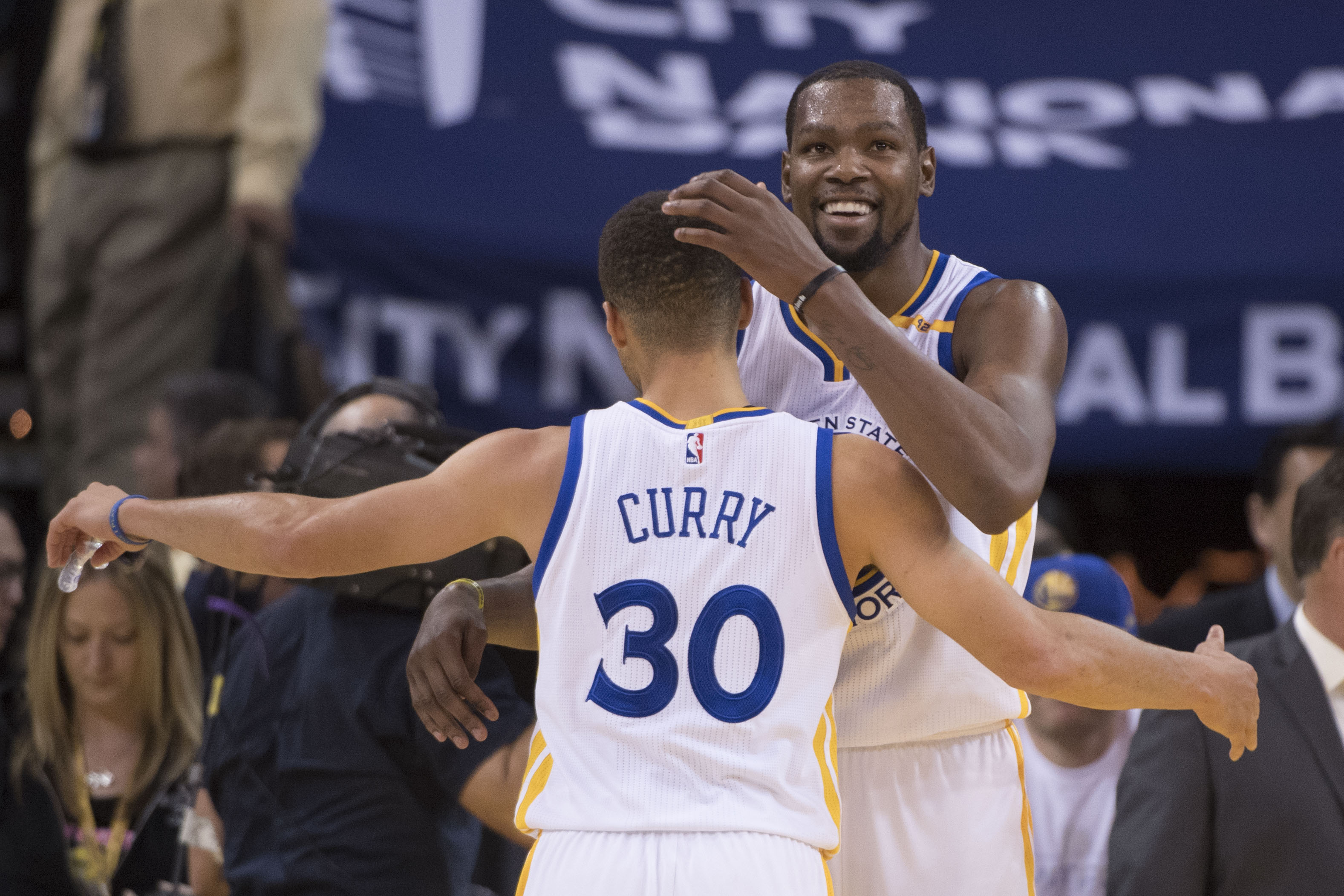 December 28, 2016; Oakland, CA, USA; Golden State Warriors forward Kevin Durant (35, right) hugs guard Stephen Curry (30) after the game against the Toronto Raptors at Oracle Arena. The Warriors defeated the Raptors 121-111. Mandatory Credit: Kyle Terada-USA TODAY Sports