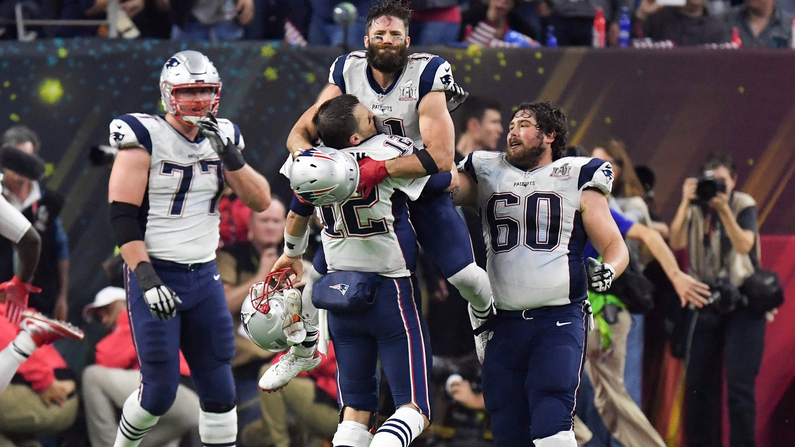 Feb 5, 2017; Houston, TX, USA; New England Patriots quarterback Tom Brady (12) and wide receiver Julian Edelman (11) celebrate their win over Atlanta Falcons during Super Bowl LI at NRG Stadium. The Patriots won 34-28. Mandatory Credit: Bob Donnan-USA TODAY Sports