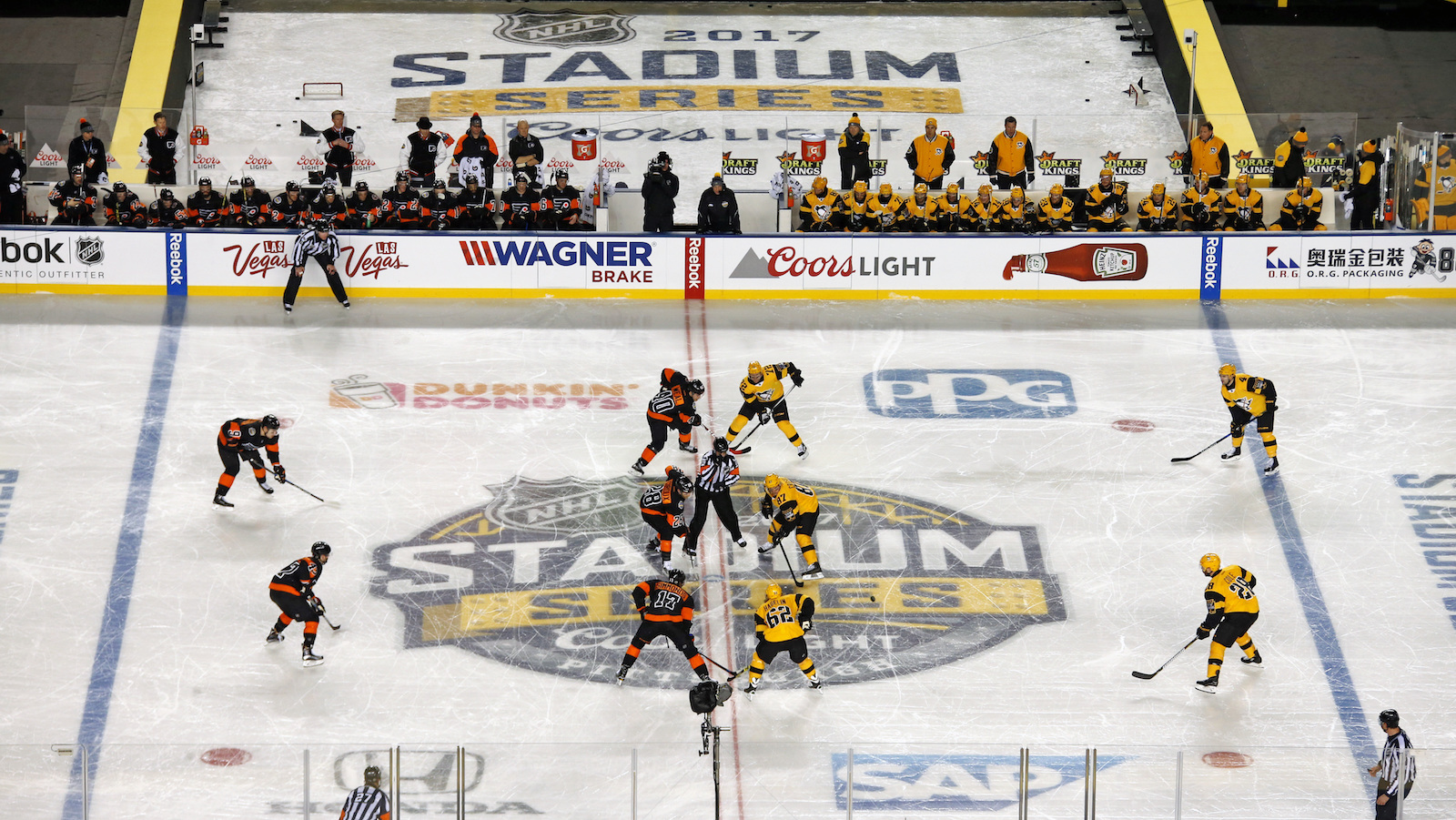 The Philadelphia Flyers and Pittsburgh Penguins get ready for the start of an NHL Stadium Series hockey game at Heinz Field in Pittsburgh, Saturday, Feb. 25, 2017. (AP Photo/Gene J. Puskar)