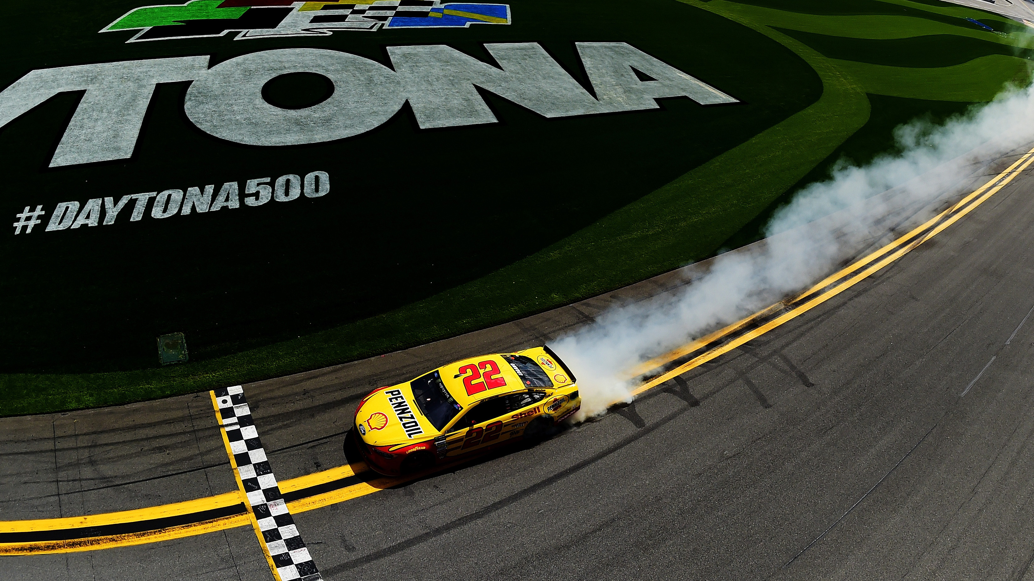 DAYTONA BEACH, FL - FEBRUARY 19:  Joey Logano, driver of the #22 Shell Pennzoil Ford, celebrates with a burnout after winning the weather delayed Monster Energy NASCAR Cup Series Advance Auto Parts Clash at Daytona International Speedway on February 19, 2017 in Daytona Beach, Florida.  (Photo by Jared C. Tilton/Getty Images)