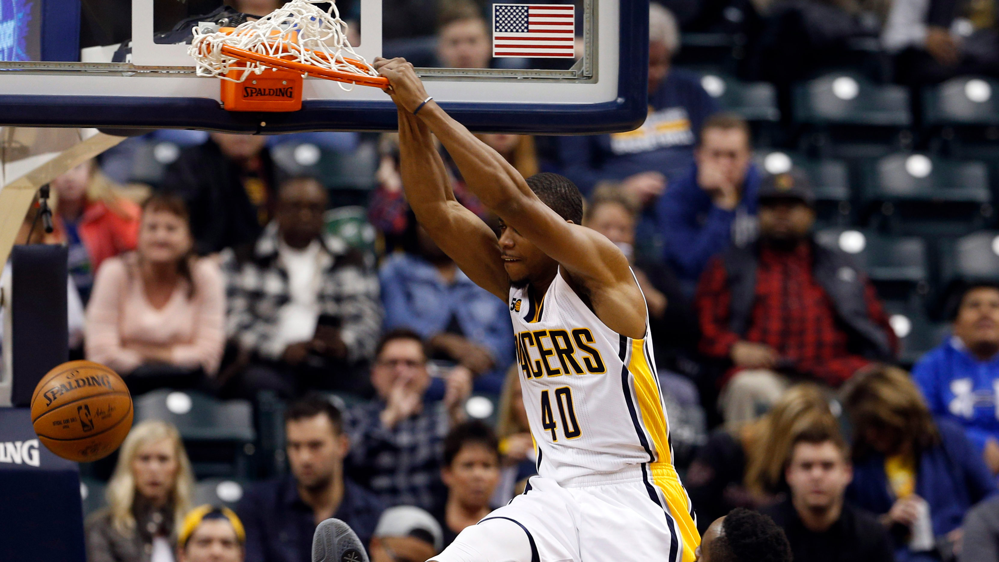 Jan 29, 2017; Indianapolis, IN, USA; Indiana Pacers forward Glenn Robinson III (40) dunks against Houston Rockets guard James Harden (13) at Bankers Life Fieldhouse. Mandatory Credit: Brian Spurlock-USA TODAY Sports