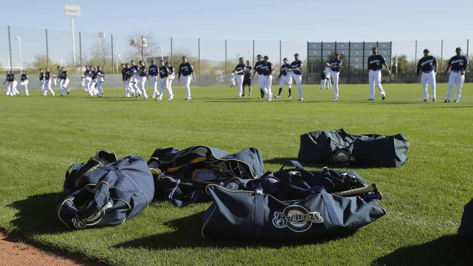 Milwaukee Brewers pitchers and catchers warm up before spring training camp at Maryvale Baseball Park in Maryvale, Ariz., on Feb. 16, 2017.