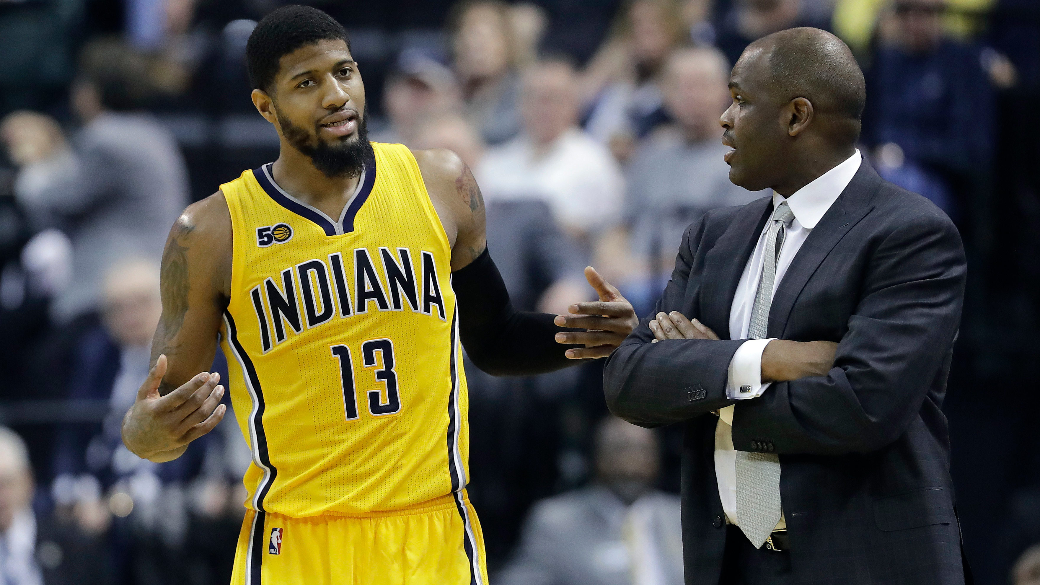 Indiana Pacers' Paul George (13) talks with head coach Nate McMillan during the second half of an NBA basketball game against the Milwaukee Bucks, Saturday, Feb. 11, 2017, in Indianapolis. (AP Photo/Darron Cummings)