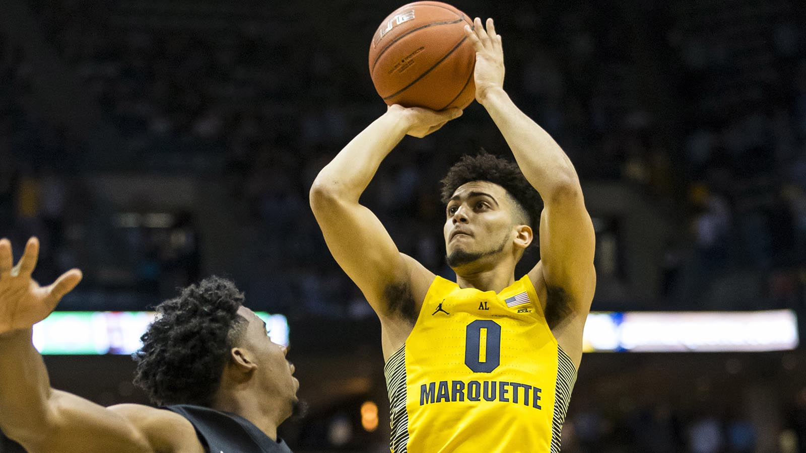 Feb 18, 2017; Milwaukee, WI, USA; Marquette Golden Eagles guard Markus Howard (0) shoots over Xavier Musketeers guard Quentin Goodin (3) during the first half at BMO Harris Bradley Center. Mandatory Credit: Jeff Hanisch-USA TODAY Sports