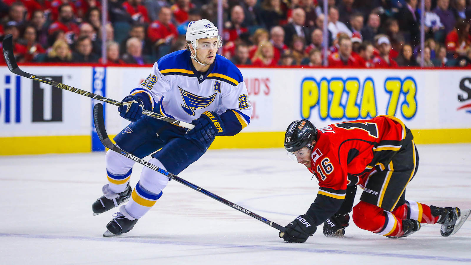Mar 14, 2016; Calgary, Alberta, CAN; St. Louis Blues defenseman Kevin Shattenkirk (22) and Calgary Flames center Josh Jooris (16) during the first period at Scotiabank Saddledome. Calgary Flames won 7-4. Mandatory Credit: Sergei Belski-USA TODAY Sports