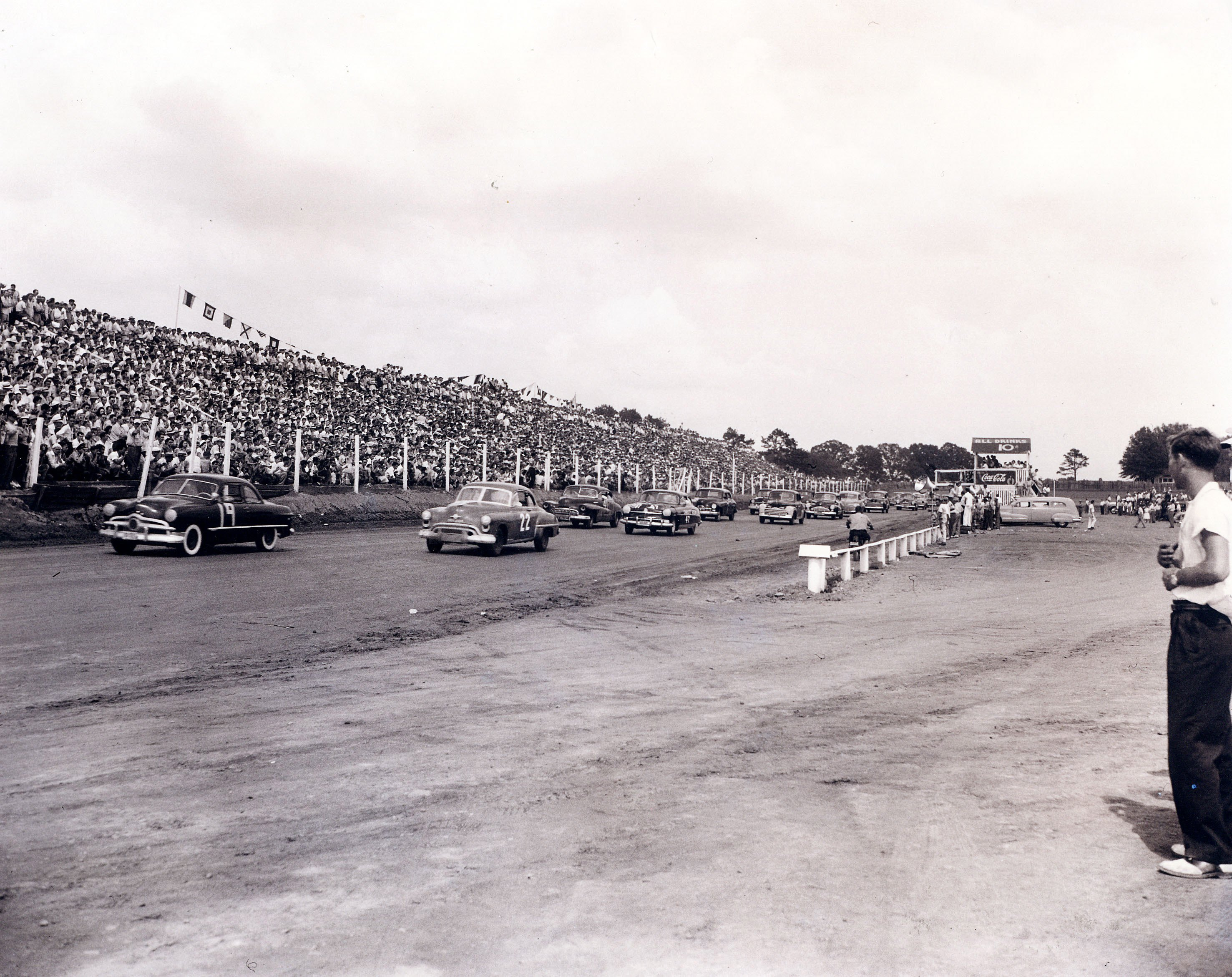 "CHARLOTTE, NC - JUNE 19, 1949:  Bill France, Sr. changes the name of NASCAR's top series from ""Strictly Stock"" to ""Grand National."" The first Strictly Stock race was contested on June 19, 1949, at Charlotte (NC) Speedway, a 3/4-mile dirt track. The first Grand National race was held on Daytona Beach, February 5, 1950.  (Photo by ISC Archives via Getty Images)"