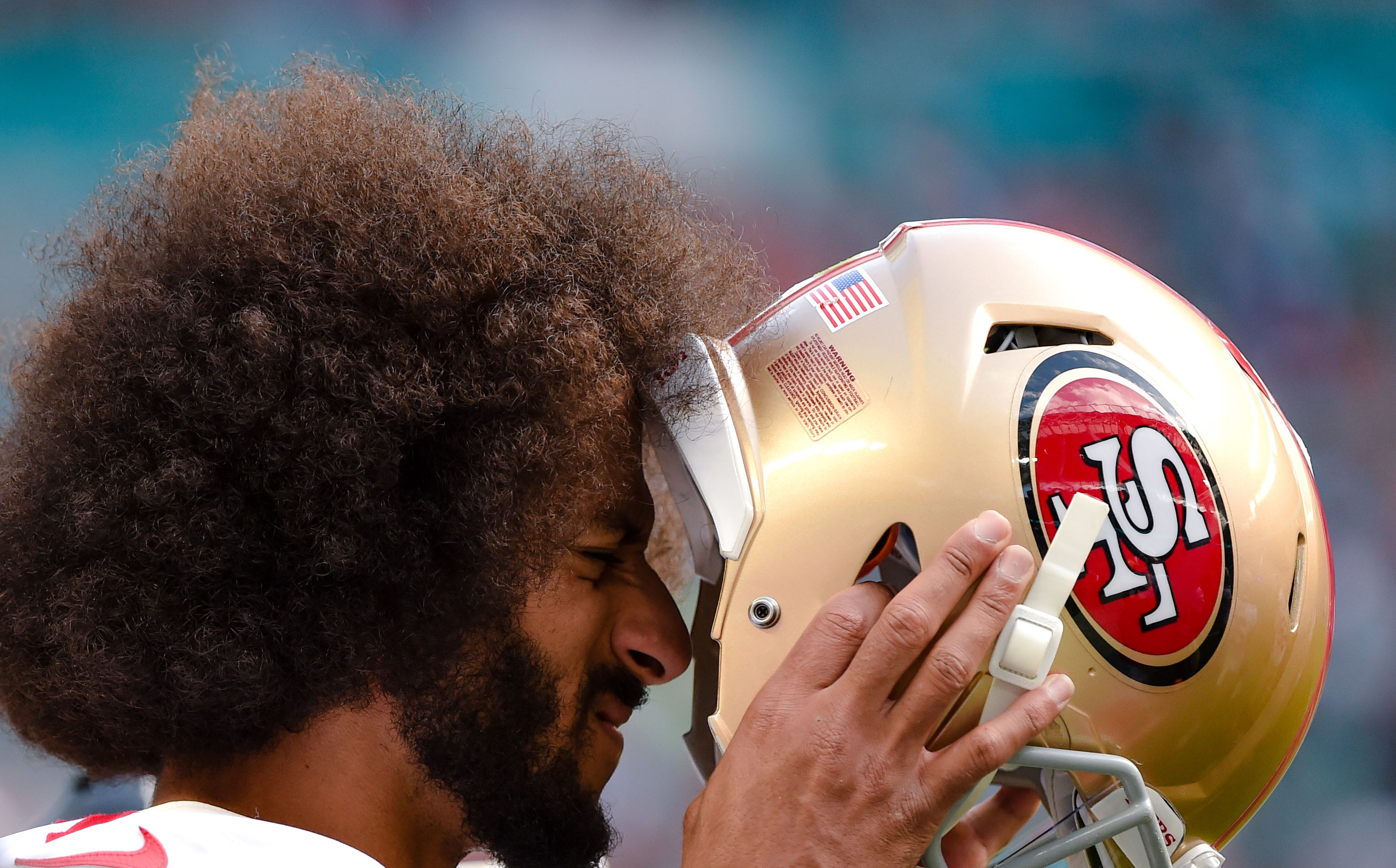 Nov 27, 2016; Miami Gardens, FL, USA; San Francisco 49ers quarterback Colin Kaepernick (7) puts on his helmet during the second half against Miami Dolphins at Hard Rock Stadium. The Dolphins won 31-24. Mandatory Credit: Steve Mitchell-USA TODAY Sports