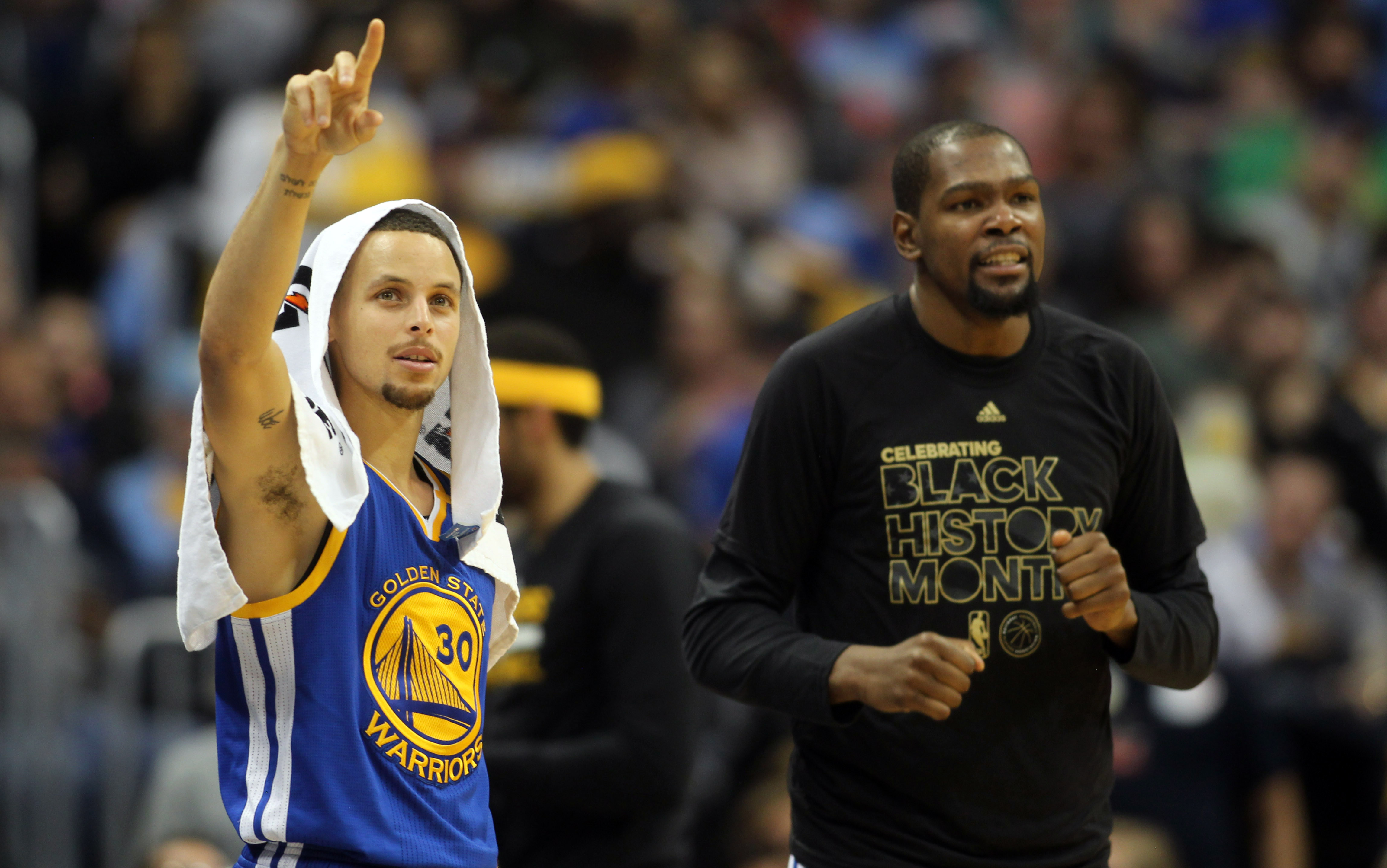 Feb 13, 2017; Denver, CO, USA; Golden State Warriors guard Stephen Curry (30) and Golden State Warriors forward Kevin Durant (35) react from the bench during the second half against the Denver Nuggets  at Pepsi Center. The Nuggets won 132-110. Mandatory Credit: Chris Humphreys-USA TODAY Sports