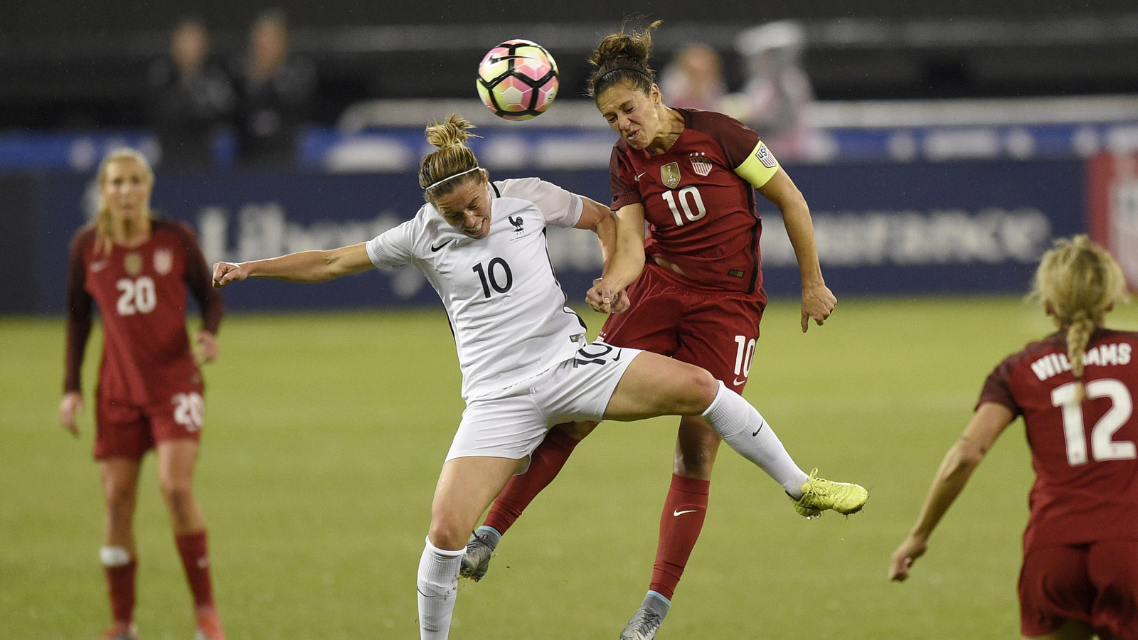 France midfielder Camille Abily, left, battles for the ball against United States midfielder Carli Lloyd, right, during the first half of a SheBelieves Cup women's soccer match, Tuesday, March 7, 2017, in Washington. (AP Photo/Nick Wass)