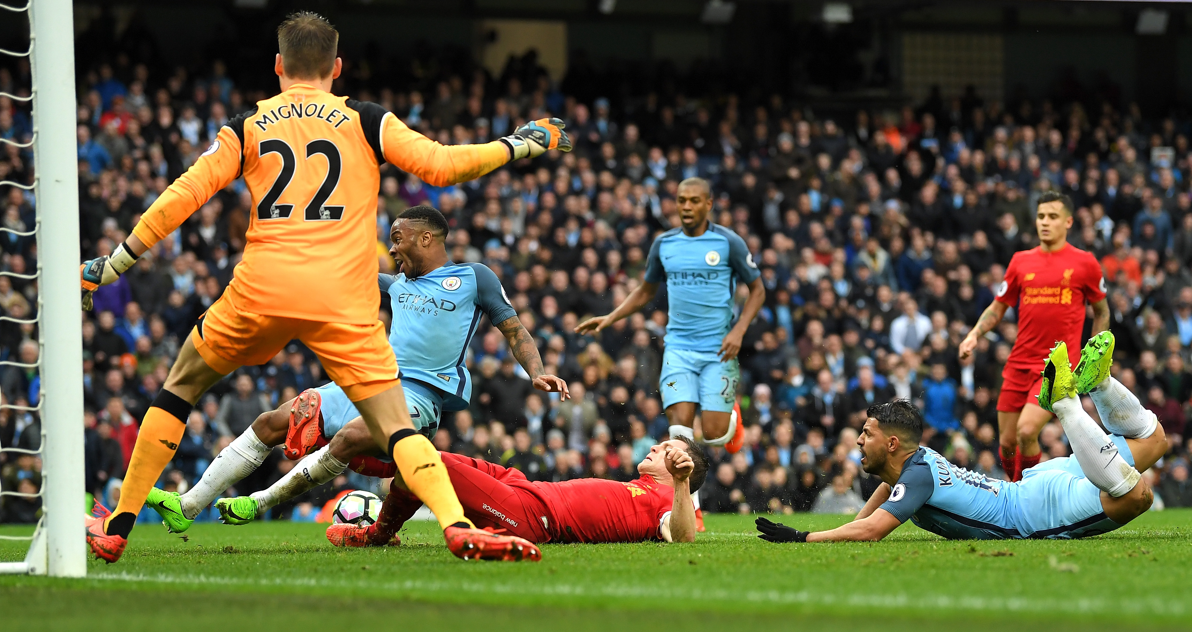 MANCHESTER, ENGLAND - MARCH 19: Raheem Sterling of Manchester City (L) is fouled by James Milner of Liverpool (C) in the penalty area during the Premier League match between Manchester City and Liverpool at Etihad Stadium on March 19, 2017 in Manchester, England.  (Photo by Laurence Griffiths/Getty Images)