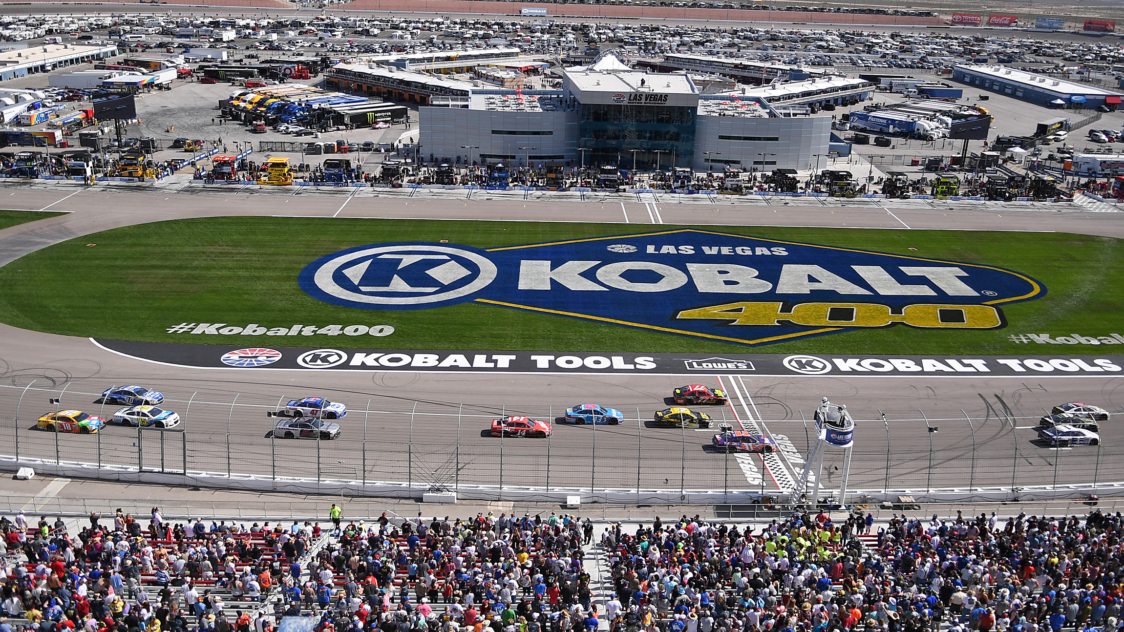 Mar 12, 2017; Las Vegas, NV, USA; Drivers complete a lap during the Kobalt 400 at Las Vegas Motor Speedway. Mandatory Credit: Stephen R. Sylvanie-USA TODAY Sports