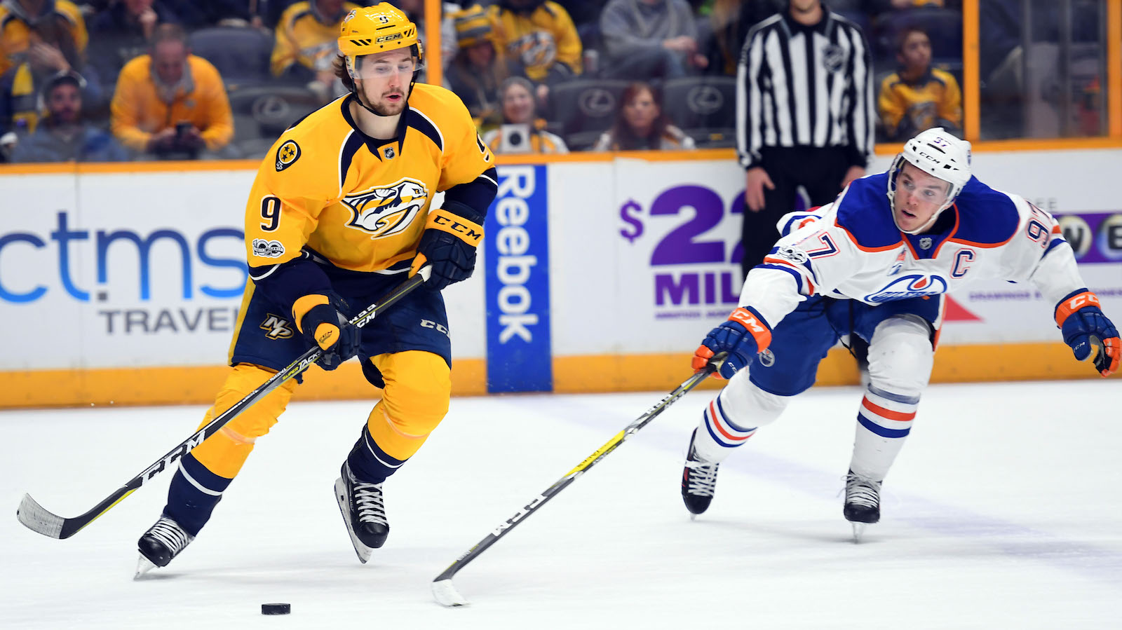 Feb 2, 2017; Nashville, TN, USA; Nashville Predators left wing Filip Forsberg (9) skates with the puck as Edmonton Oilers center Connor McDavid (97) chases during the second period at Bridgestone Arena. Mandatory Credit: Christopher Hanewinckel-USA TODAY Sports