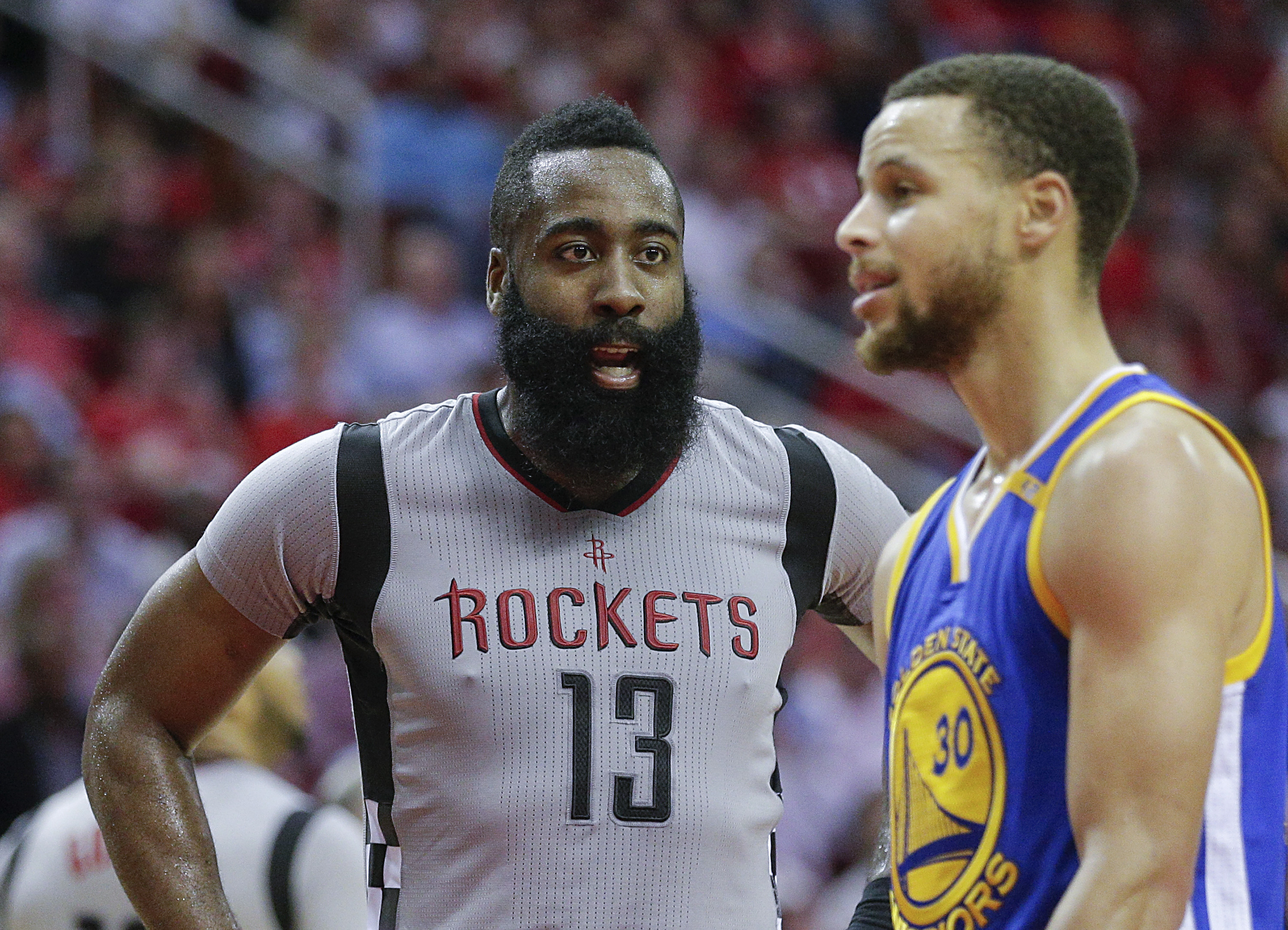 Mar 28, 2017; Houston, TX, USA; Houston Rockets guard James Harden (13) and Golden State Warriors guard Stephen Curry (30) exchange words in the second half at Toyota Center. Mandatory Credit: Golden State Warriors won 113-106. Thomas B. Shea-USA TODAY Sports