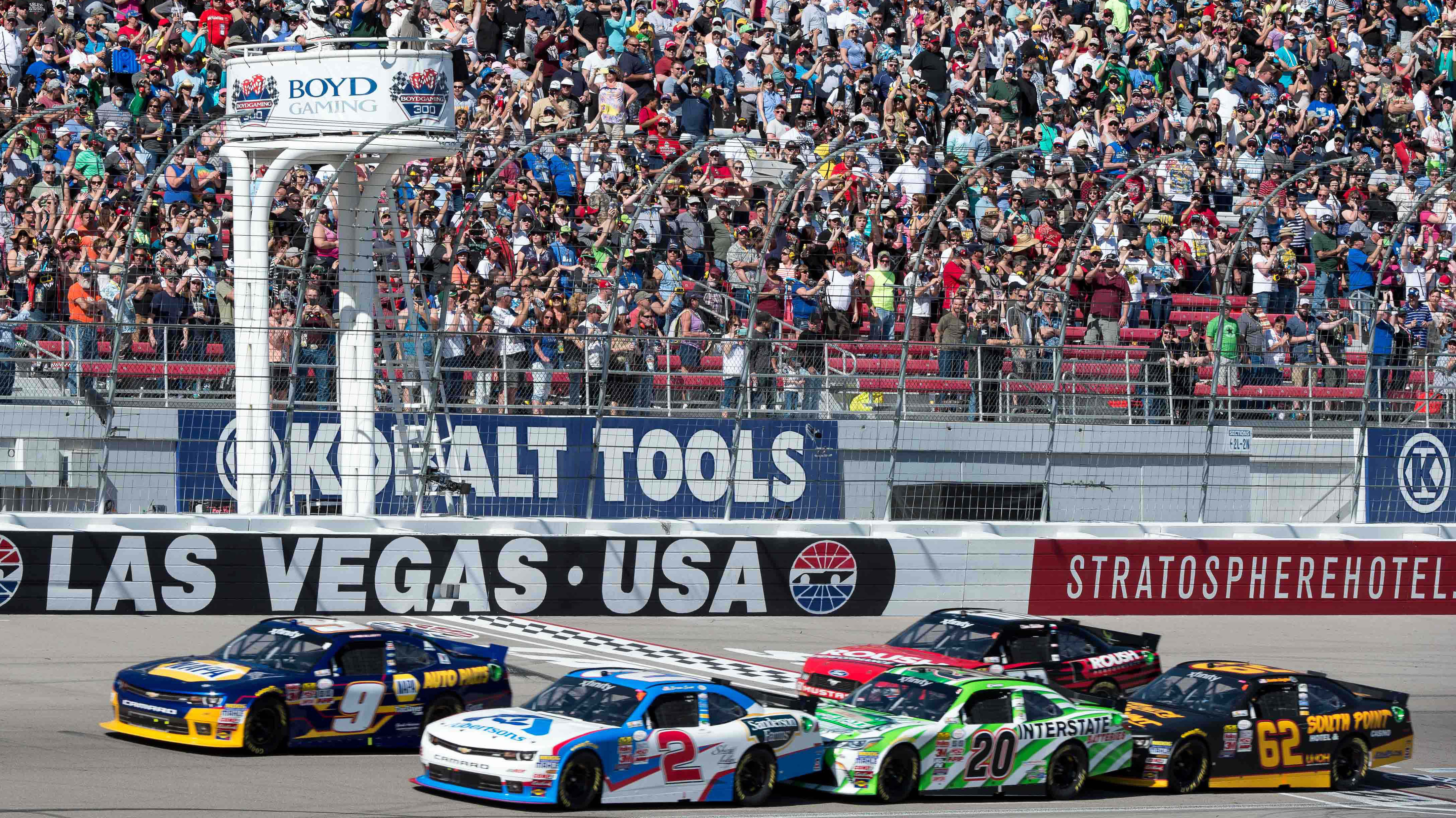 Mar 7, 2015; Las Vegas, NV, USA; NASCAR Xfinity Series driver Chase Elliott (9) and driver Brian Scott (2) and driver Erik Jones (20) and driver Brendan Gaughan (62) at the start of the Boyd Gaming 300 at Las Vegas Motor Speedway. Mandatory Credit: Jerome Miron-USA TODAY Sports