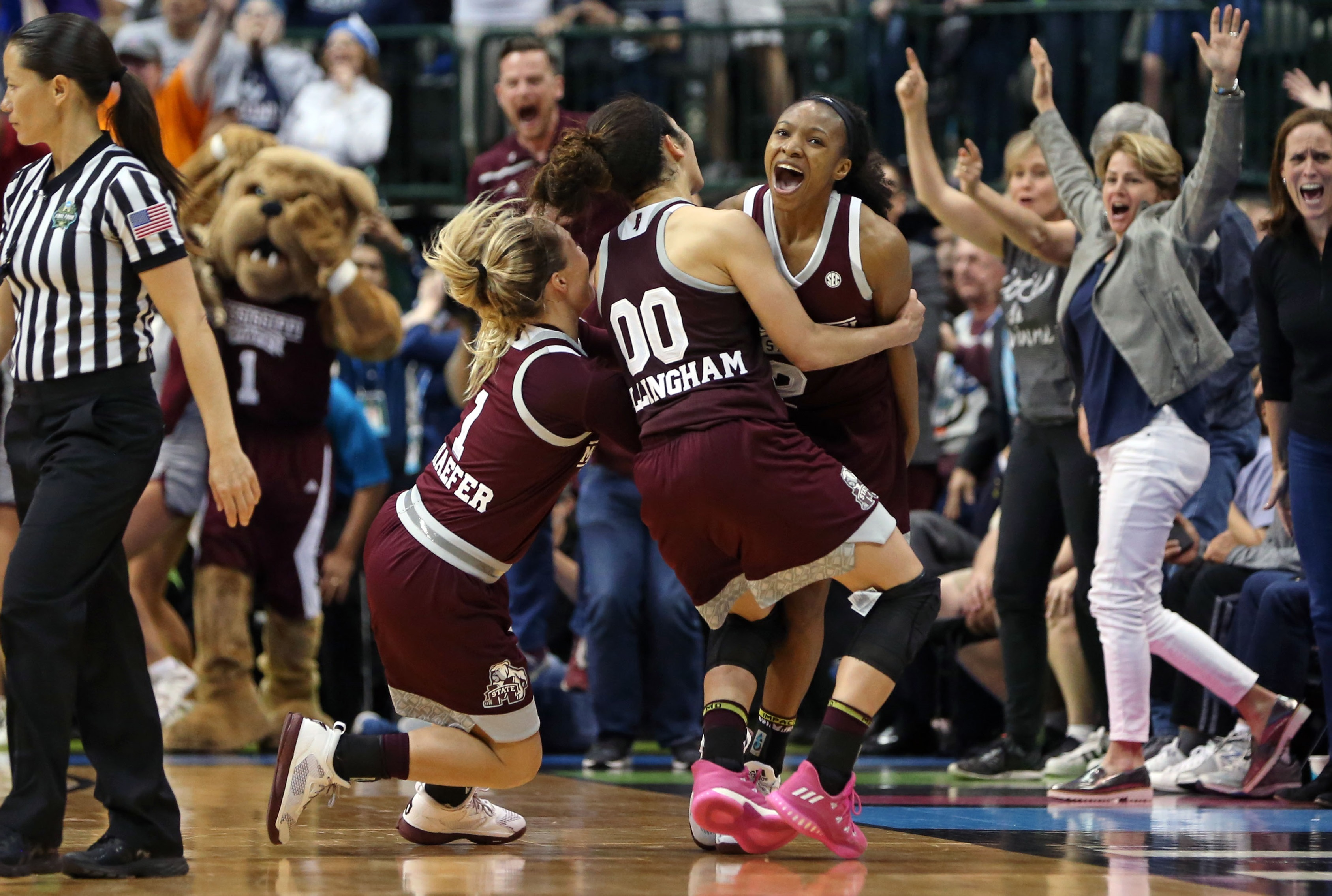 Mar 31, 2017; Dallas, TX, USA; Mississippi State Lady Bulldogs guard Blair Schaefer (1) and guard Dominique Dillingham (00) and guard Morgan William (2) celebrate defeating the Connecticut Huskies in overtime in the semifinals of the women's Final Four at American Airlines Center. Mandatory Credit: Kevin Jairaj-USA TODAY Sports