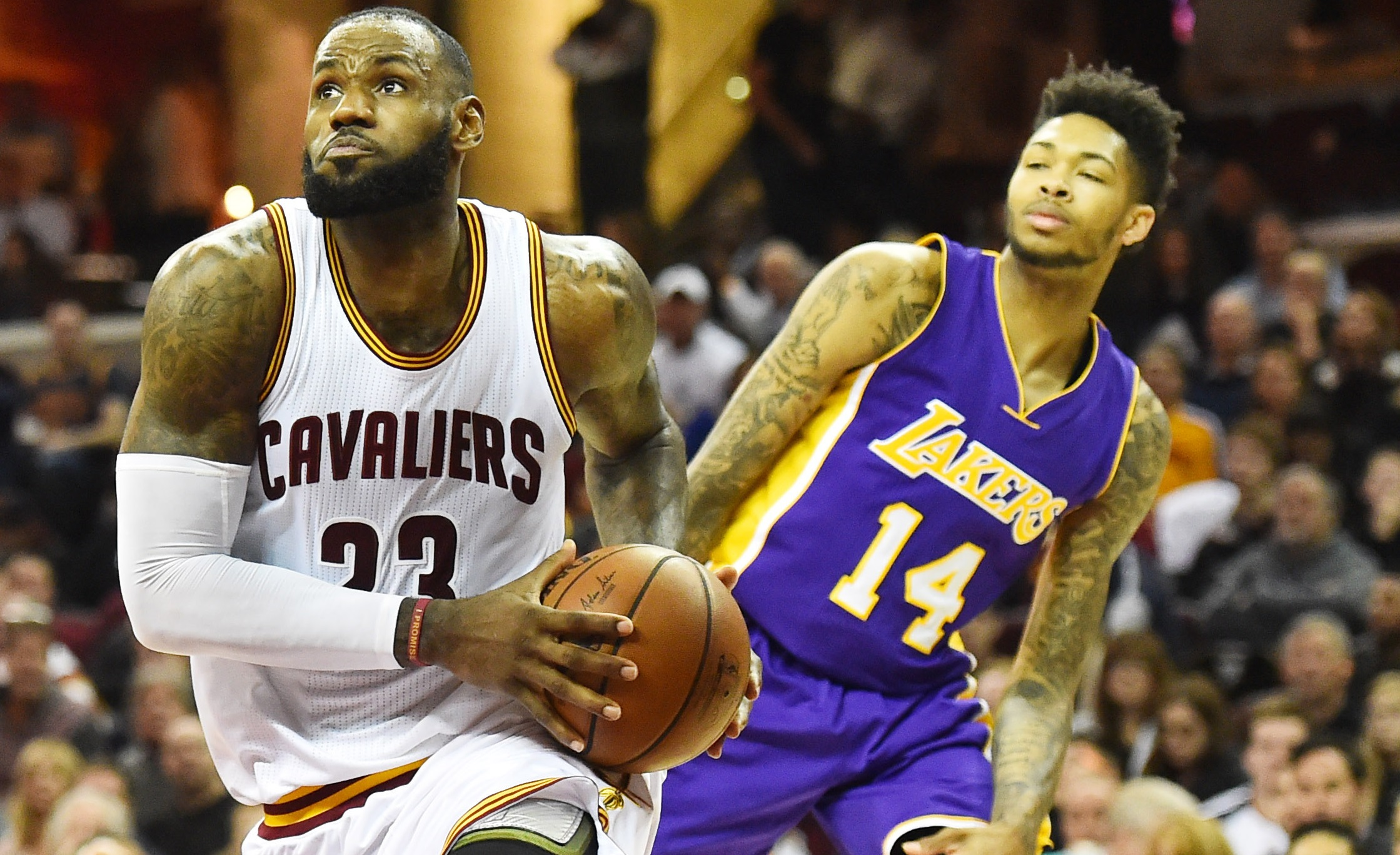 Dec 17, 2016; Cleveland, OH, USA; Cleveland Cavaliers forward LeBron James (23) drives to the basket against Los Angeles Lakers forward Brandon Ingram (14) during the second half at Quicken Loans Arena. The Cavs won 119-108. Mandatory Credit: Ken Blaze-USA TODAY Sports